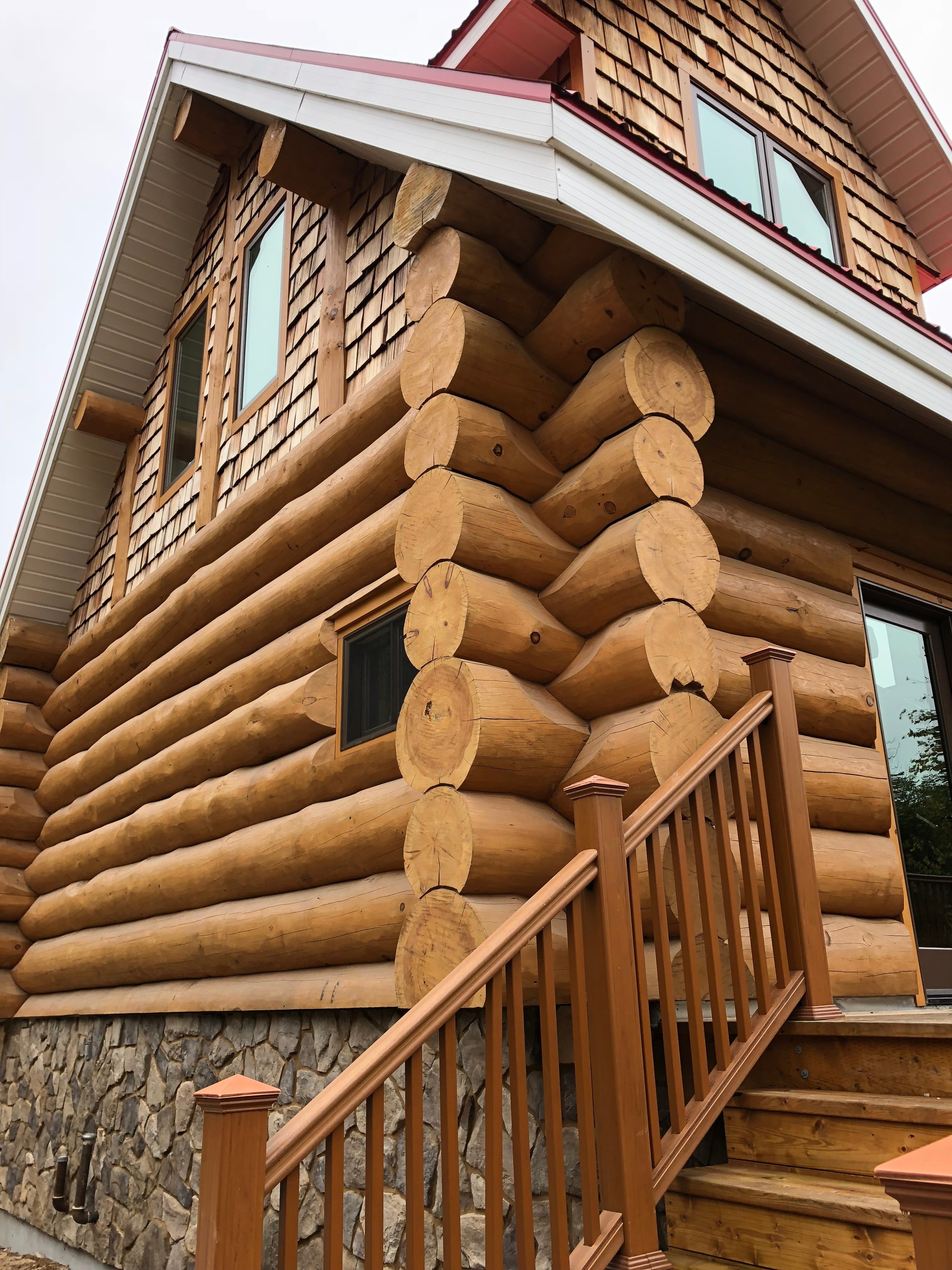 log home with stone foundation