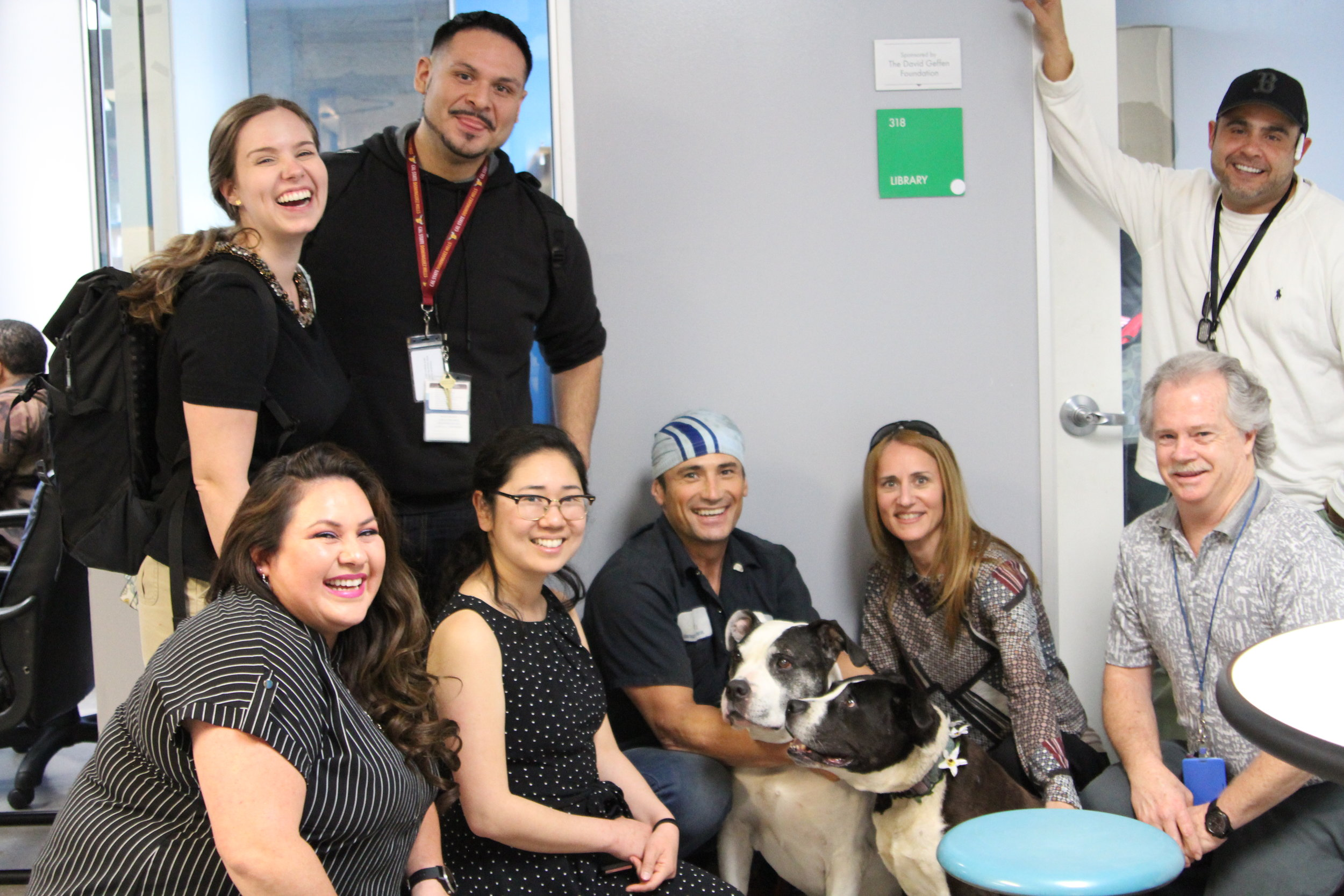 Staff and clients from My Dog is My Home, PATH, and Bark Avenue Foundation after training.