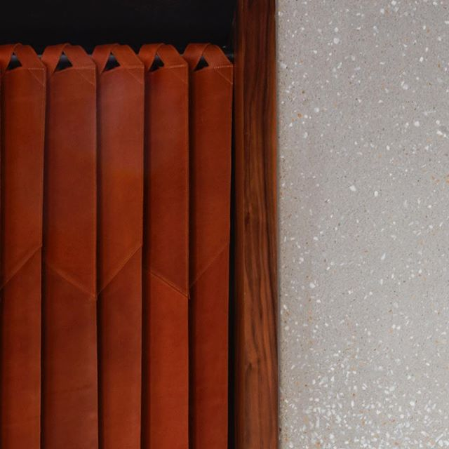 Leather door close-up, inspired by meat fridge plastic curtains.  Strips of leather held from the top by straps in cross directions to create a tilt in direction. @skirtbeirut  #mariagroup