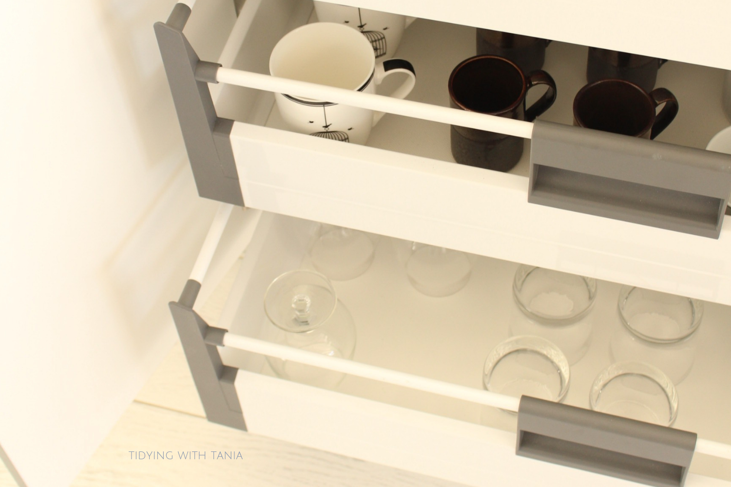 kitchen drawers with glasses and cups