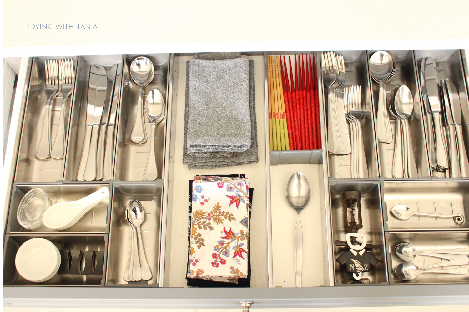 organised kitchen cutlery drawer.png