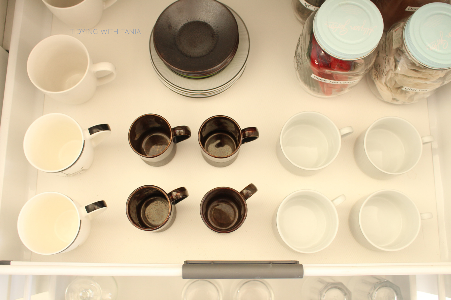 mugs and cups in drawer.png