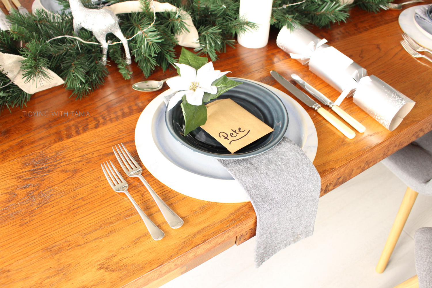 Christmas place setting with napkin under plate.png