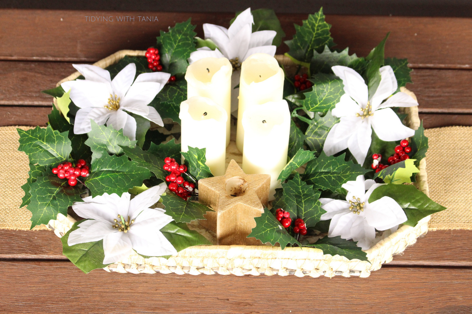 Christmas candles and holy hock in outside table centrepiece.png