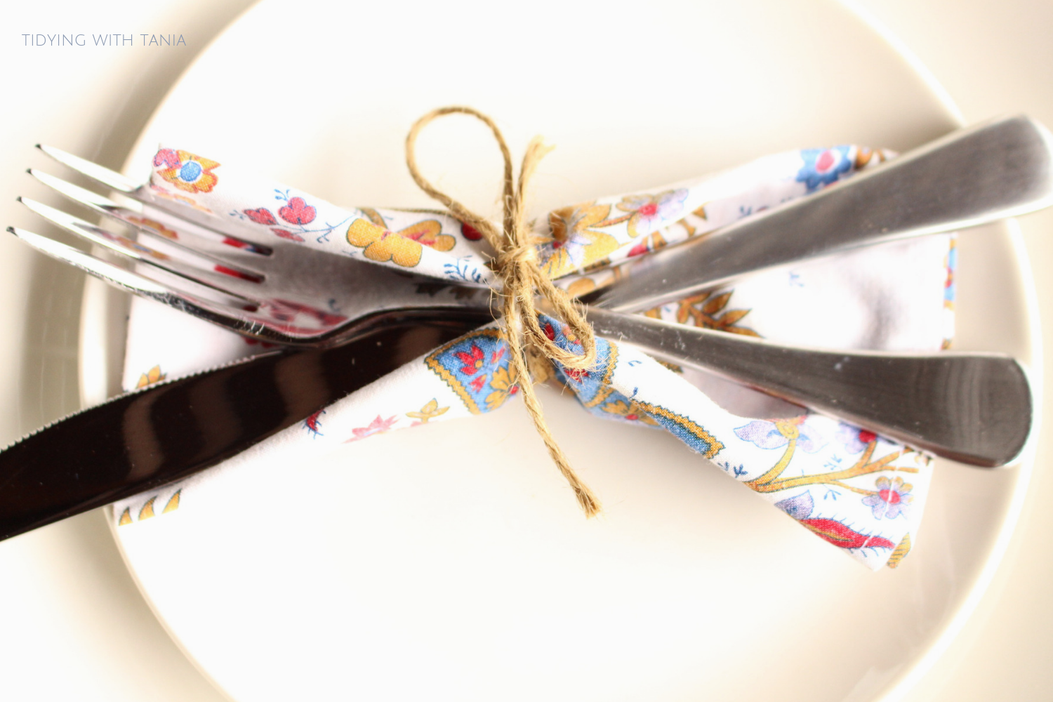 knife and fork tied around napkin for table setting.png