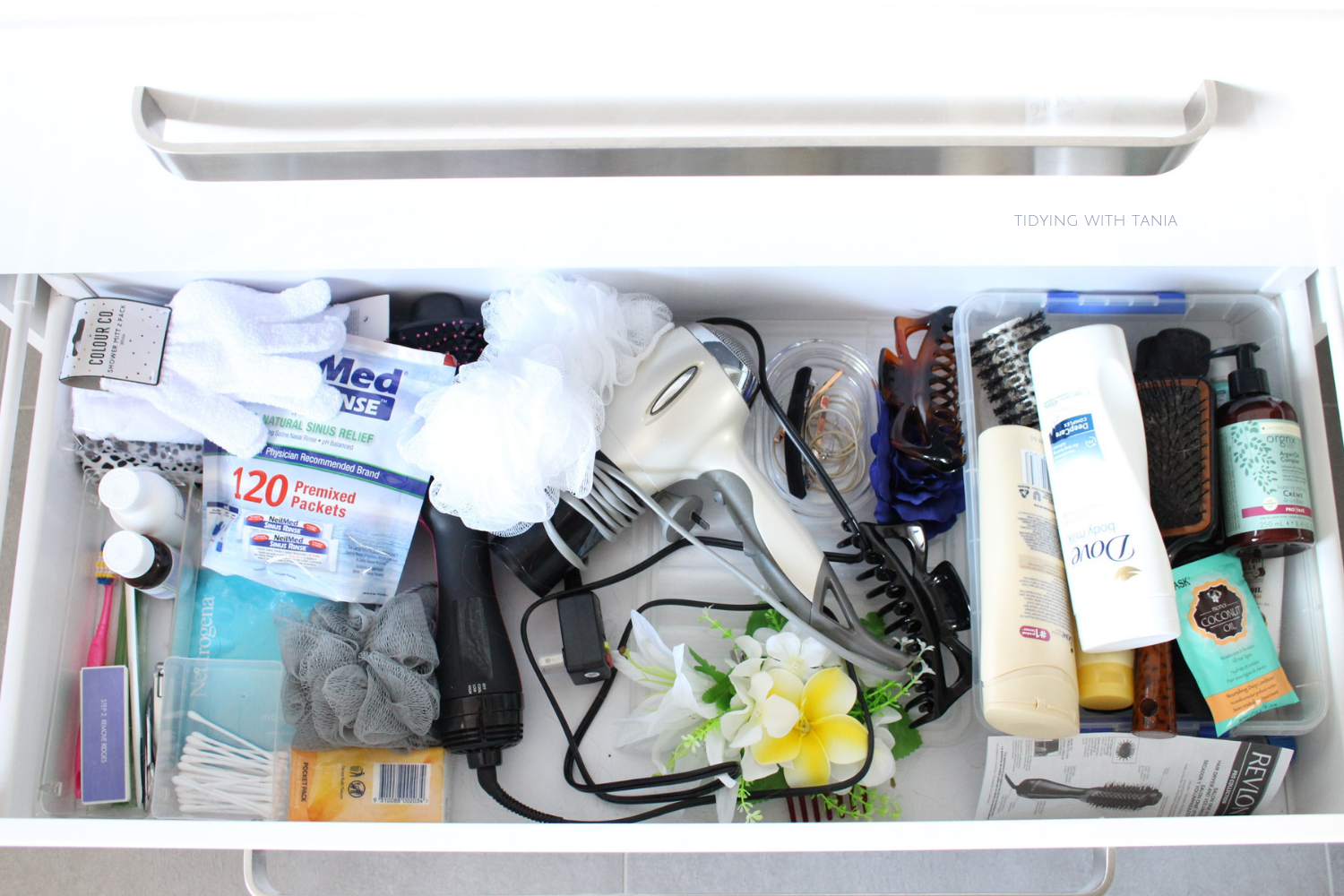 Bathroom drawer open and messy.png