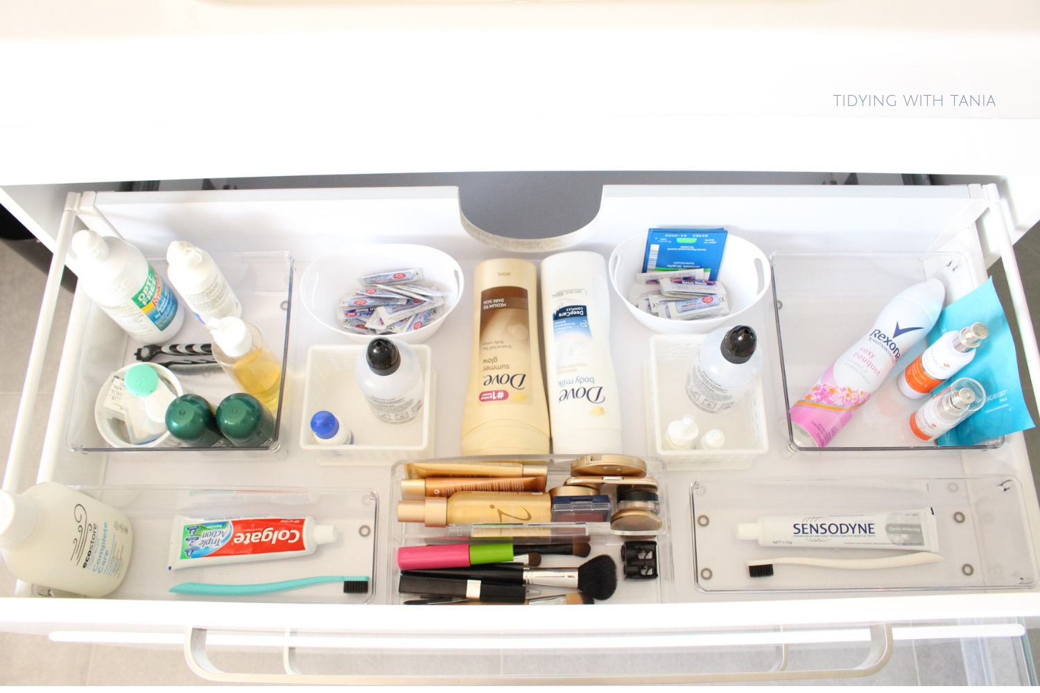 Bathroom drawer organized make up and oral products.png