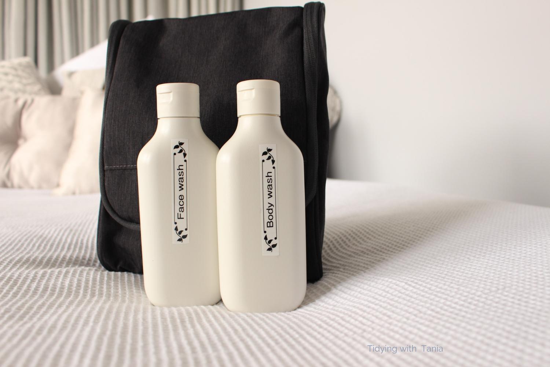 Wash bag with travel bottles.png