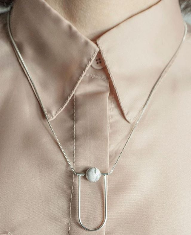 Find Necklace Neutra, carefully hand made in sterling silver by us in Stockholm! Available at @designtorget  in Sweden and EU via their online store!  For this picture, the beautiful garment is made by the Vasc Country Fashion Label based in Barcelona @loidi_collection #silvercollection #silvernecklace#howlitestone #sustainablejewelry #ethicallymade #scandinavianjewelry #nordicaesthetic #simplejewellery #geometricjewellery #minimalstyle