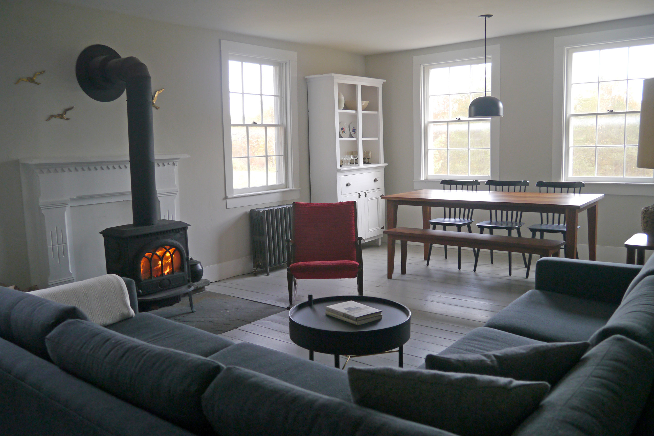 Living Room - Includes dining area with a long farm table that seats up to 8