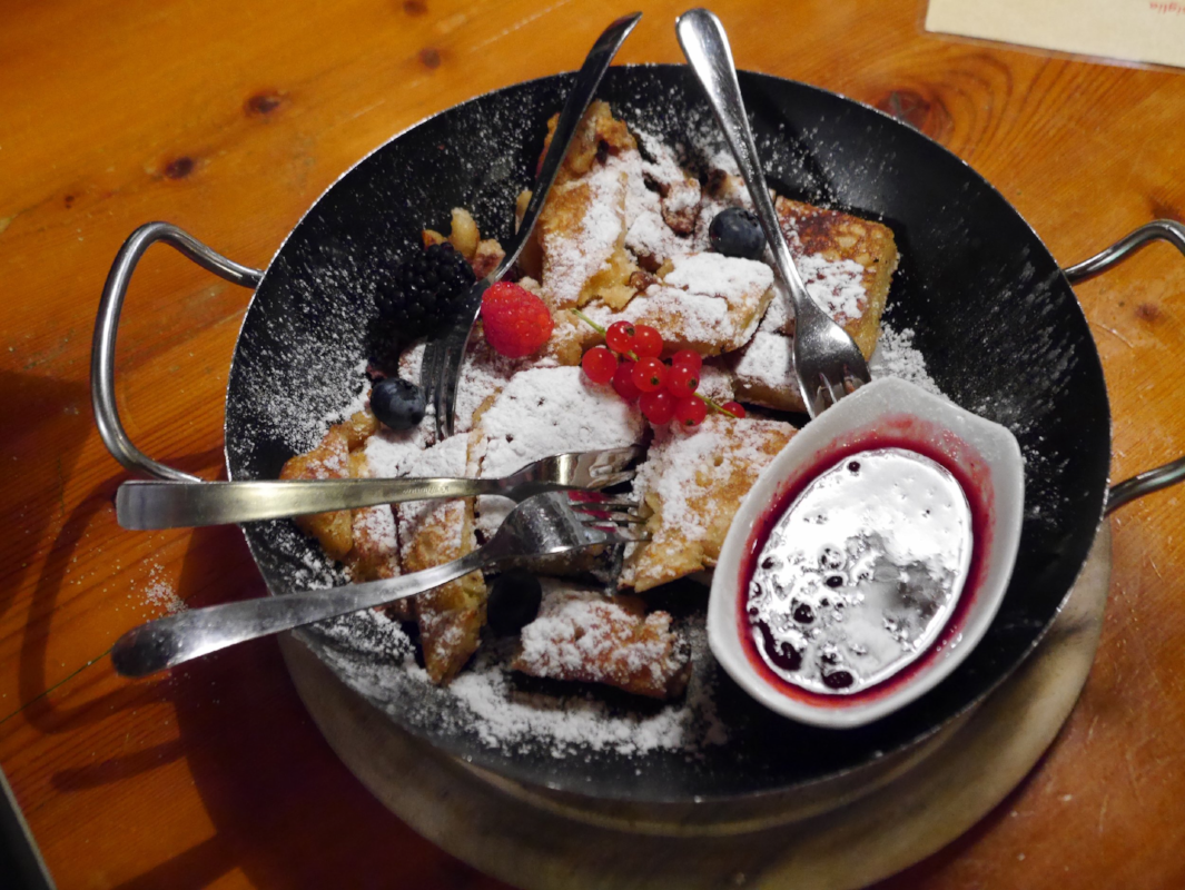 Unfortunately I can't remember the name of this dessert. It's typical of the area and is something between a bread and butter pudding and pancakes topped with fresh berries, icing sugar and berry coulis.