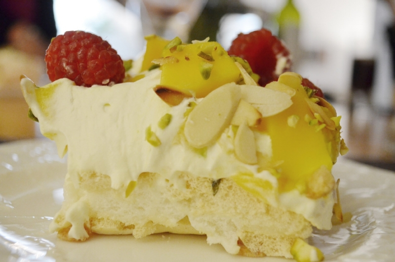 Mouth-watering rosewater and pistachio meringue with almonds, raspberries and mango