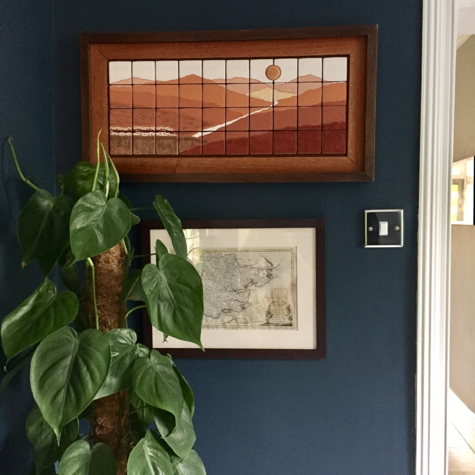 Devil's Ivy plant (ideal for rooms with limited light). A piece of art from the Chicamocha Canyon in Colombia, and an antique map of Essex we found in a market in Florence.