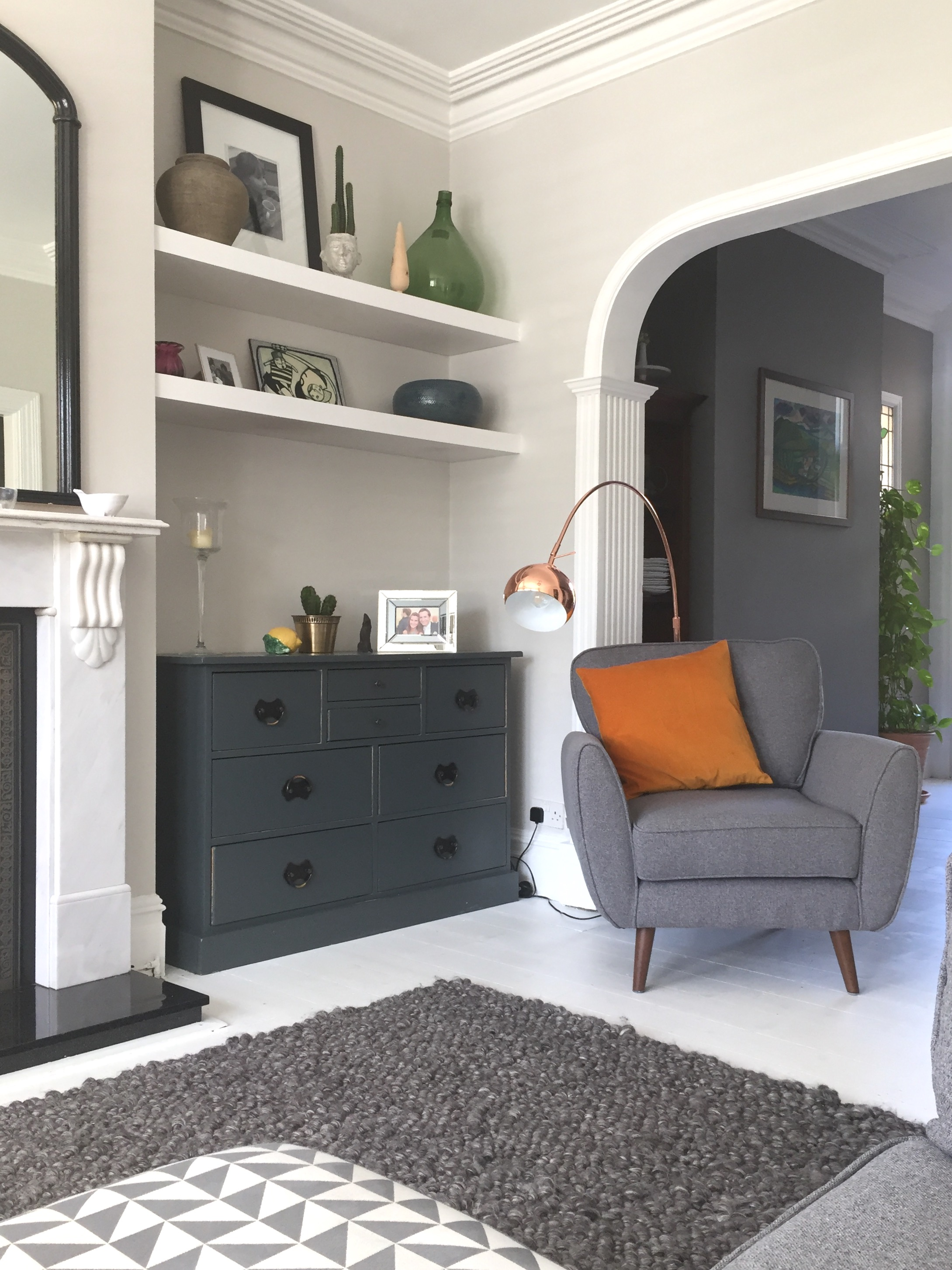 We had some shelves built into the alcoves. We also stripped and repainted the dresser that was left behind buy the previous owners in  Farrow and Ball's Downpipe.
