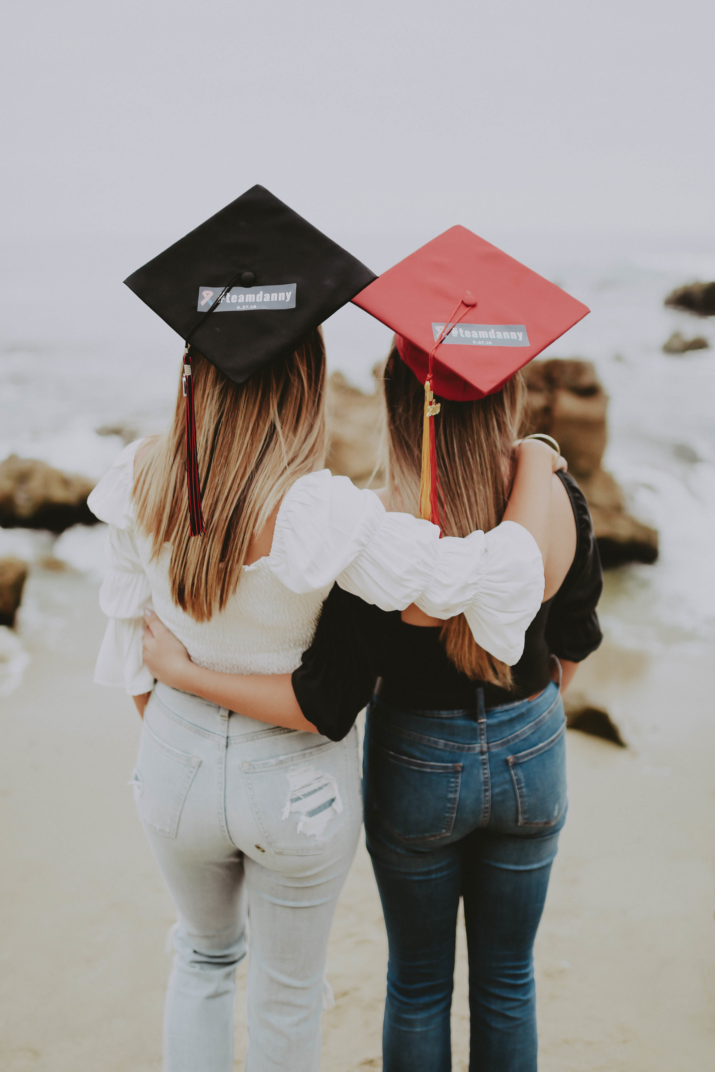 The Kirby girls sporting their #TeamDanny stickers on their graduation caps in honor of their late father, Danny Kirby.