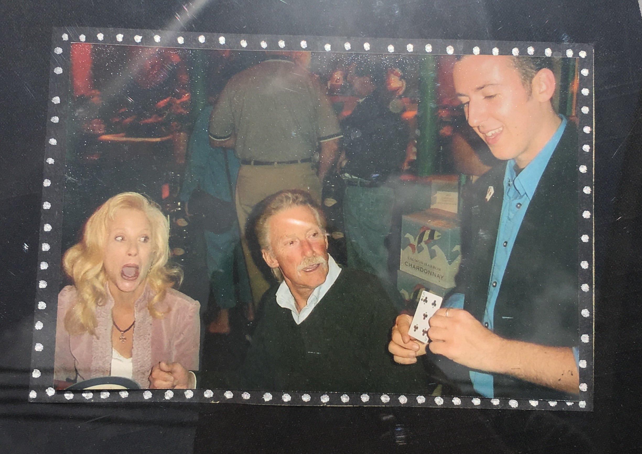 Performing magic at restaurant, age 19