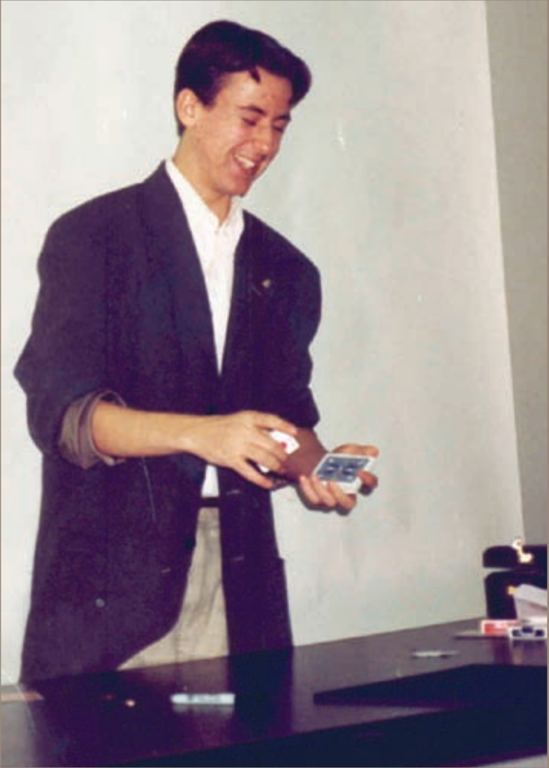15-year-old Kostya teaching magic to a group of young magicians in New York City.