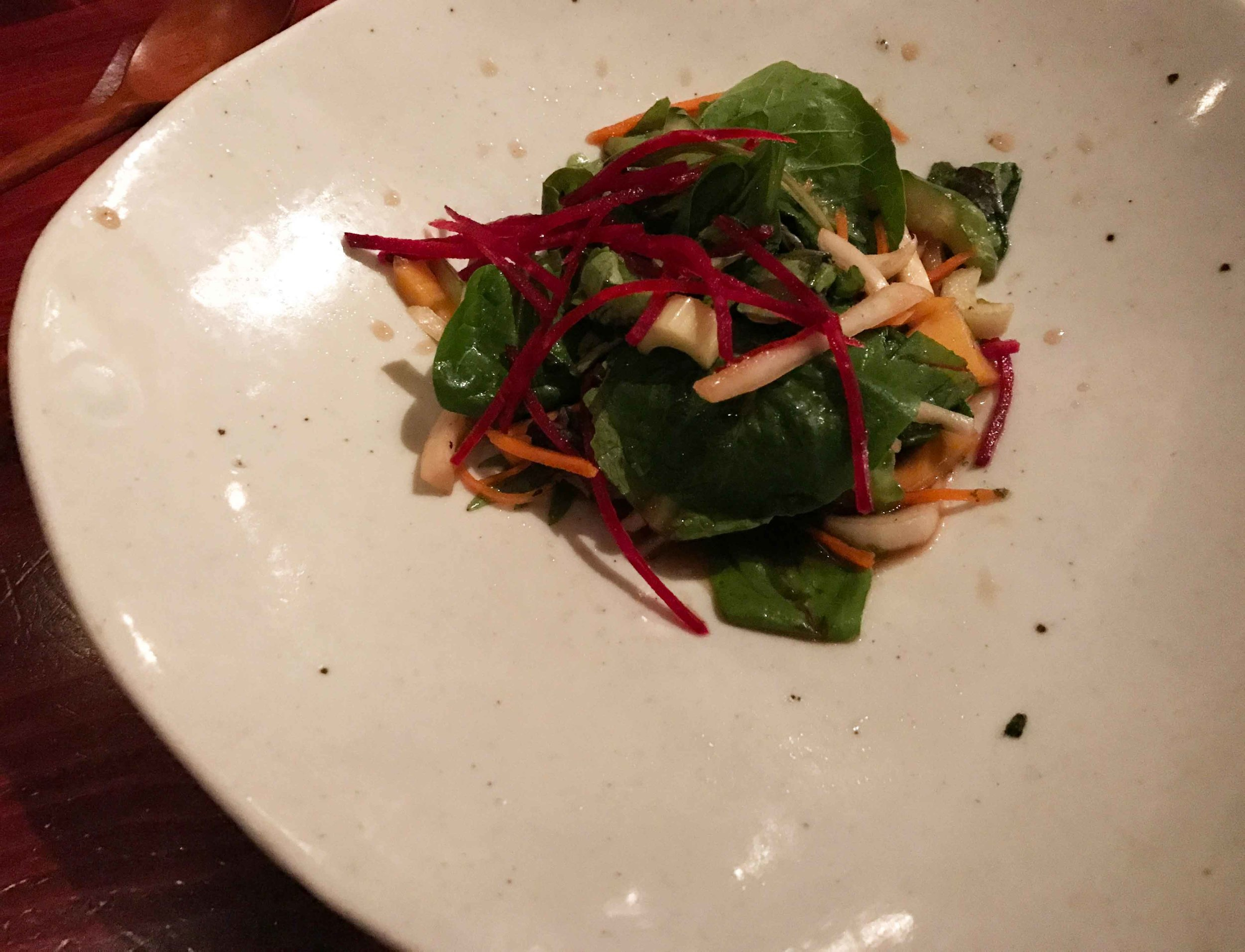Bell flower root and celery salad with mixed greens, persimmon, and cucumber in Korean apricot dressing.
