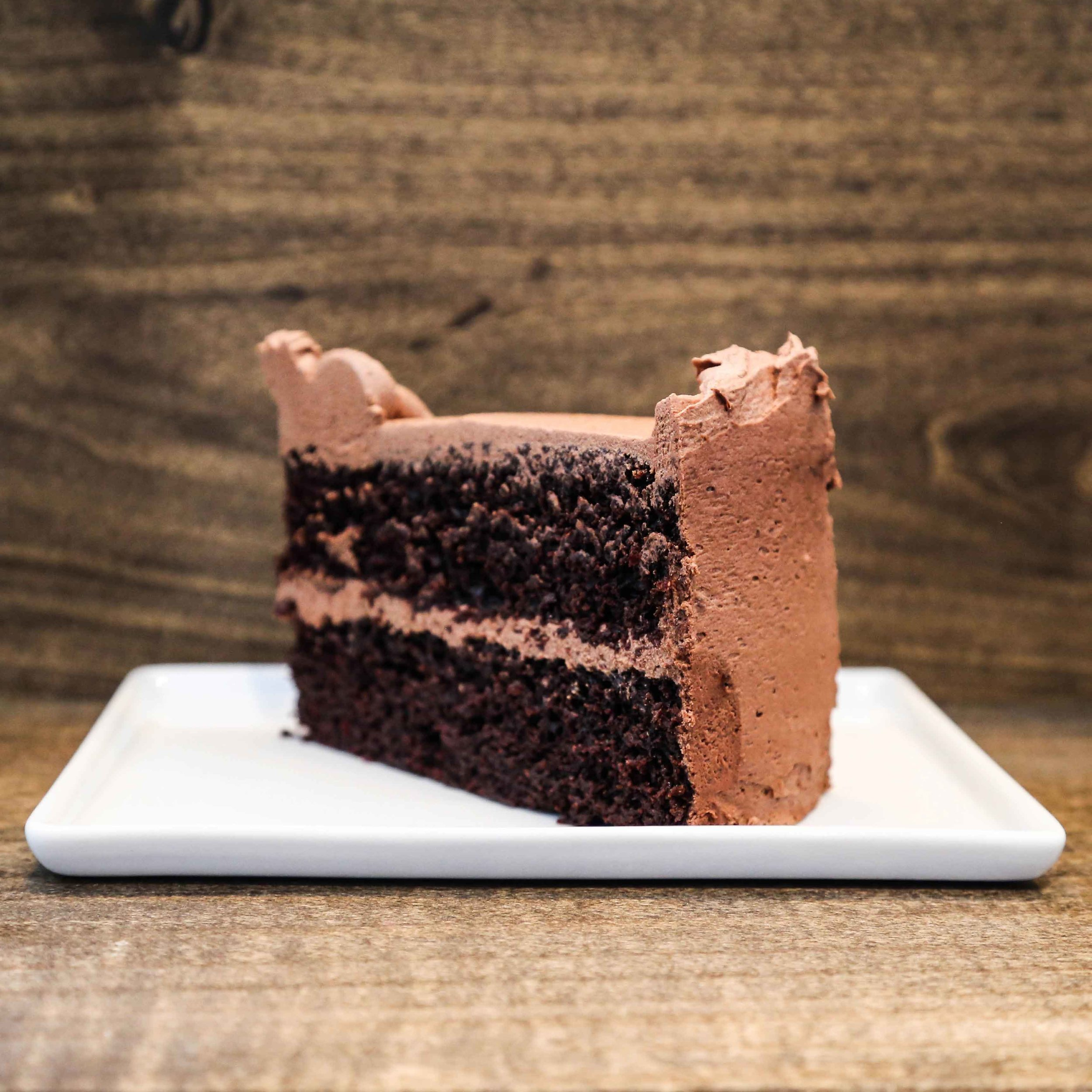 Double Chocolate Layer Cake ($8/a slice)  - dark chocolate, double layer, creamy organic soy chocolate icing