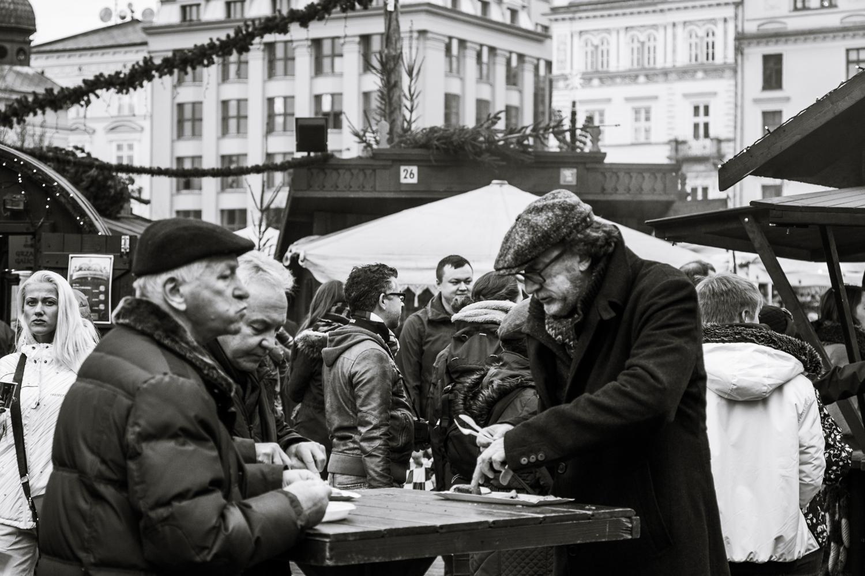 Men enjoying Krakow food