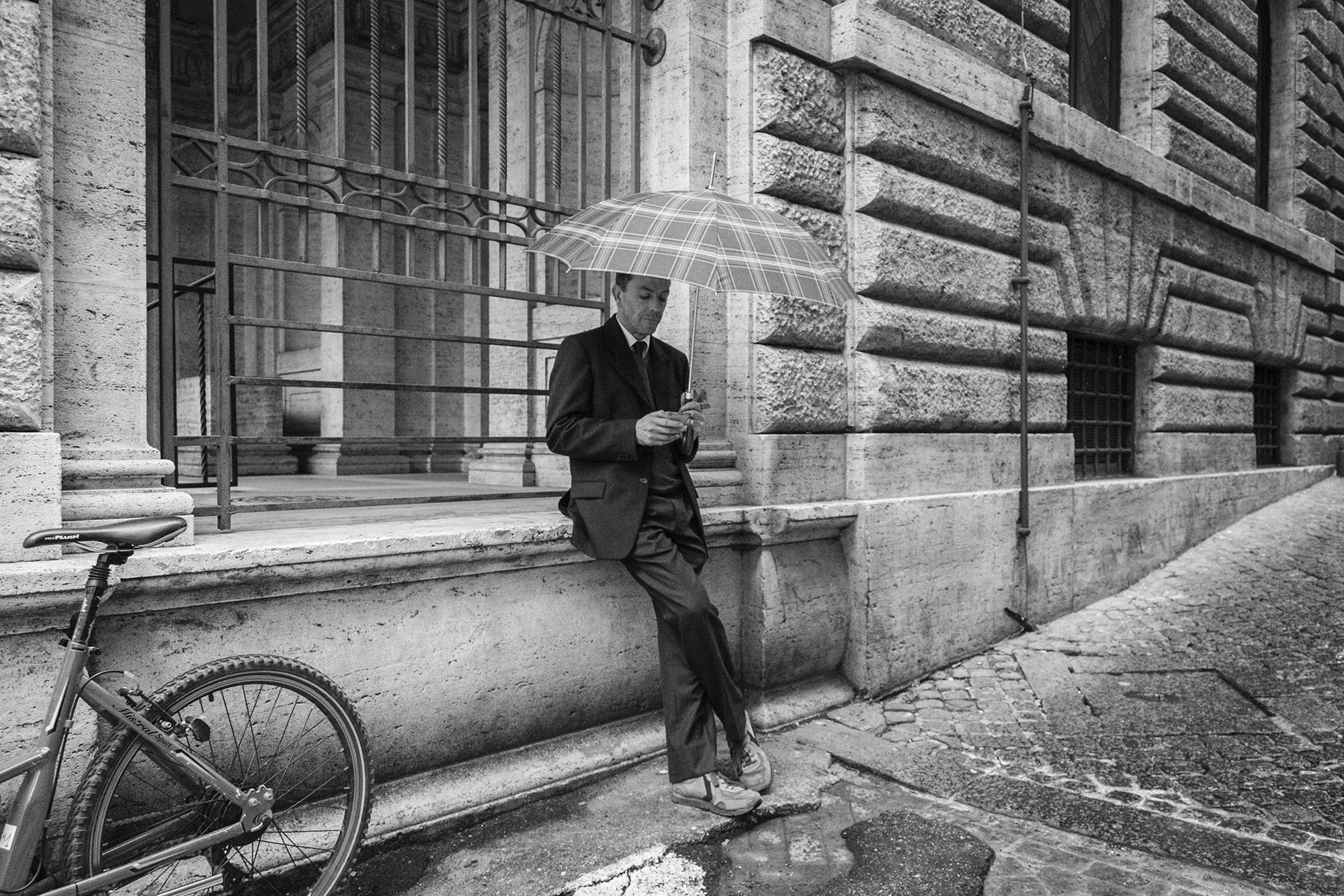 A man under the umbrella.