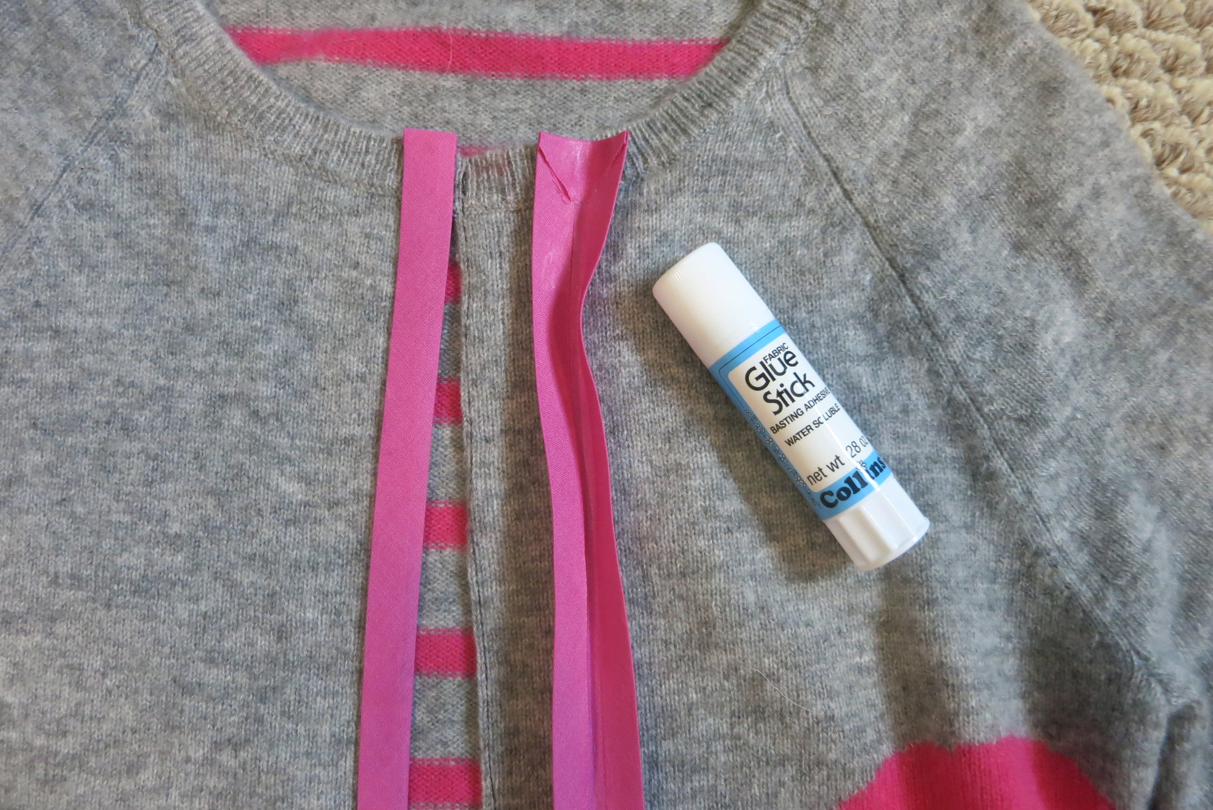 "Use ""Basting adhesive"" fabric glue stick or pin to hold the bias tape in place."