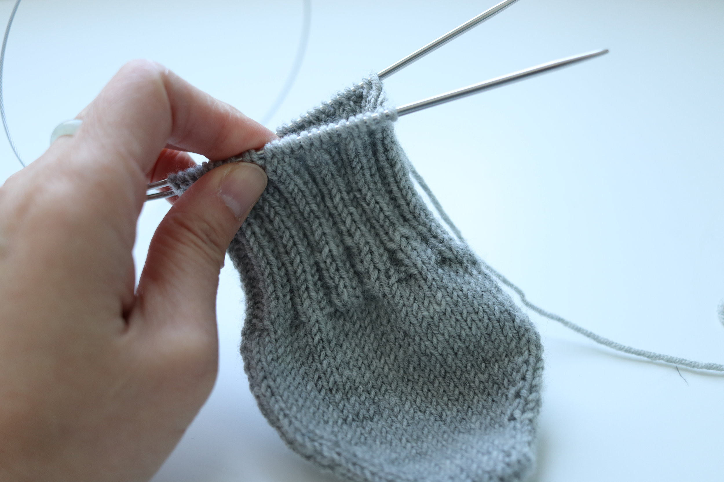 Socks knitting with ribbing in the middle part of the foot.