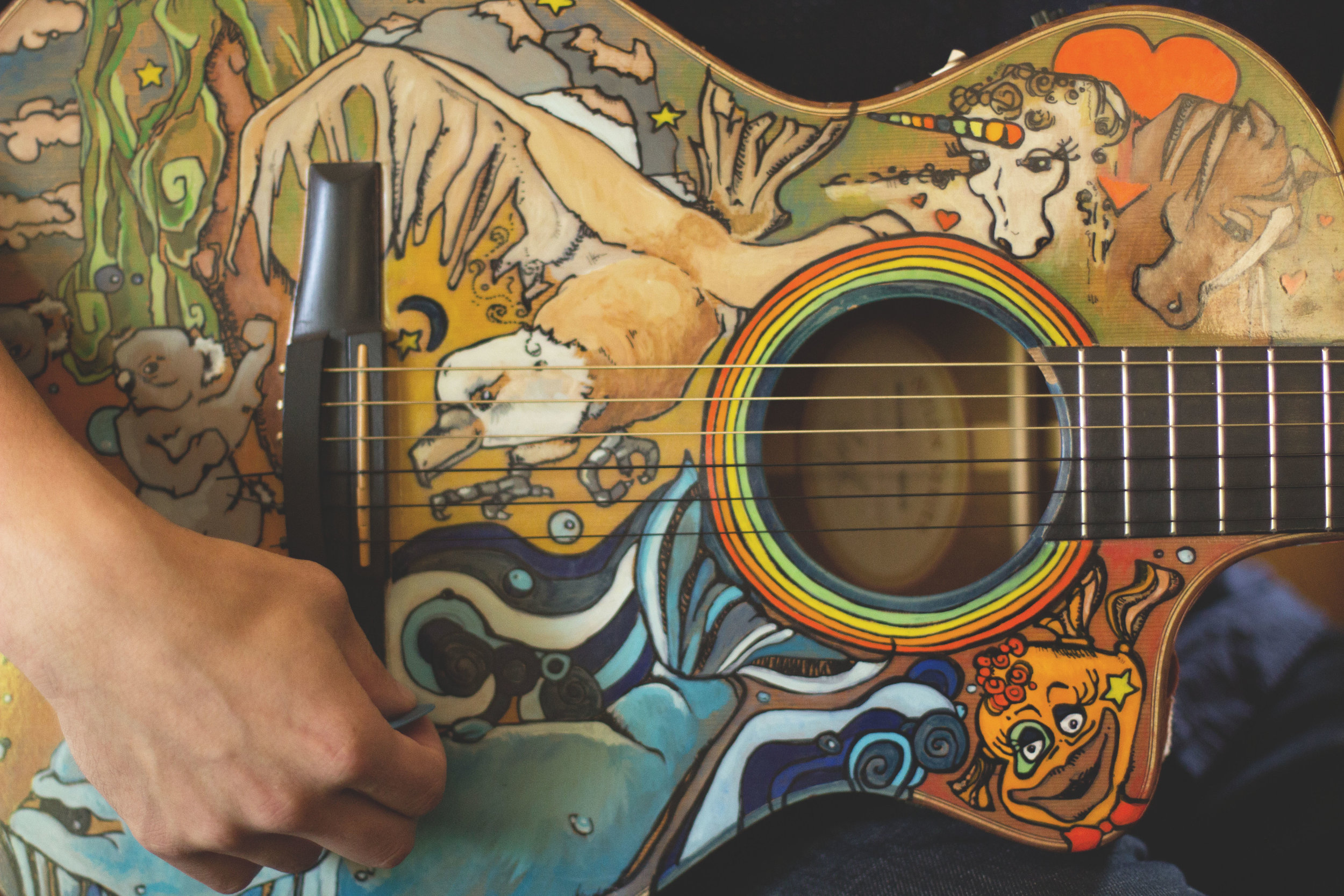 A guitar worth a thousand songs. Painting by Leah Tumerman.