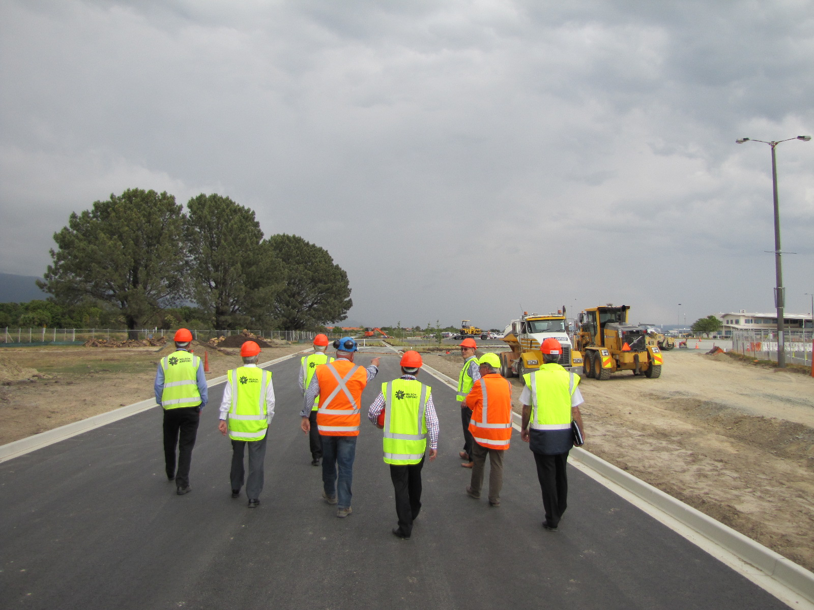 Councillors and invited guests walk the new entrance and ring road before it opens to the public.