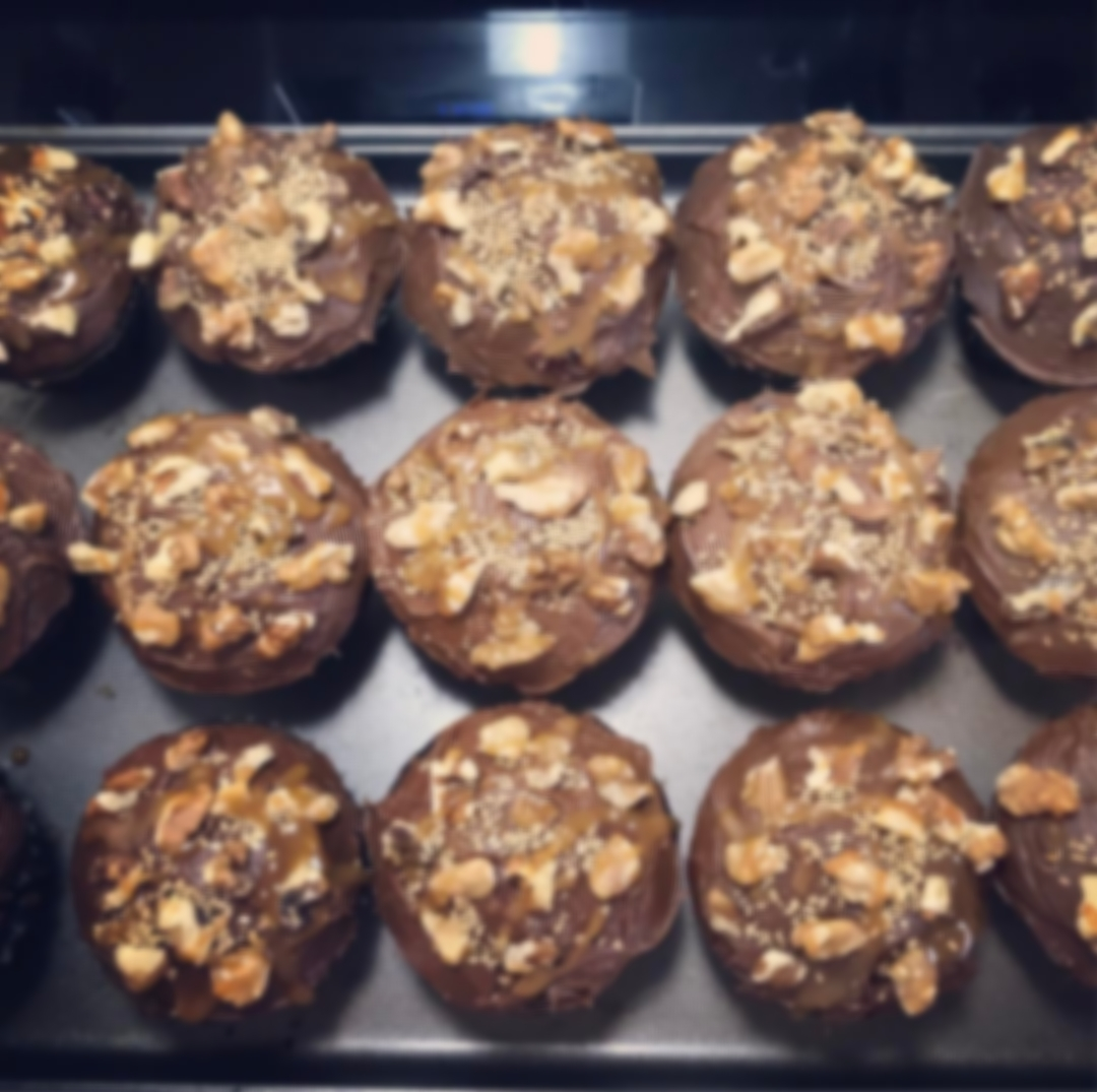 Derby Cupcakes - Chocolate bourbon cake topped with walnuts, drizzled in salted caramel, dusted with gold sprinkles