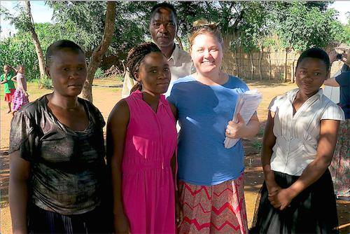 I traveled to the home of this moderator (far left) and met her family while I picked up the surveys she completed for me! Zikomo kwamberi, Mphatso!