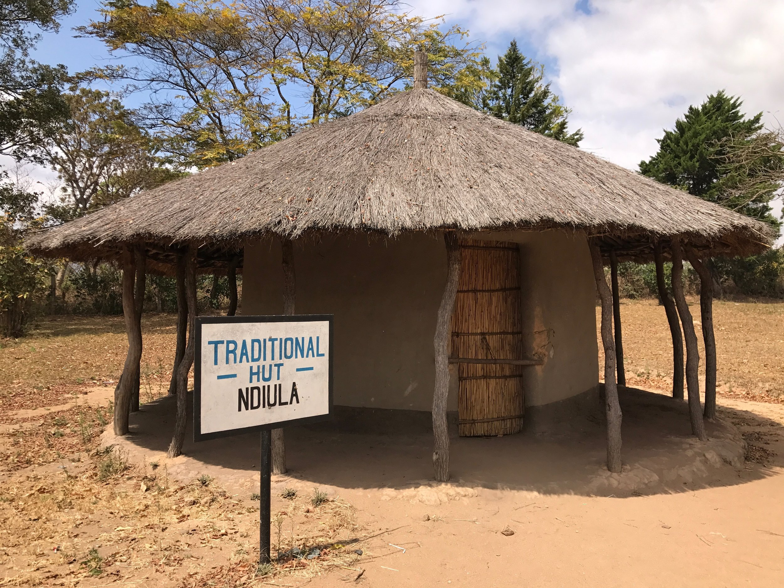 The traditional hut, fully furnished inside, used for education demonstrations