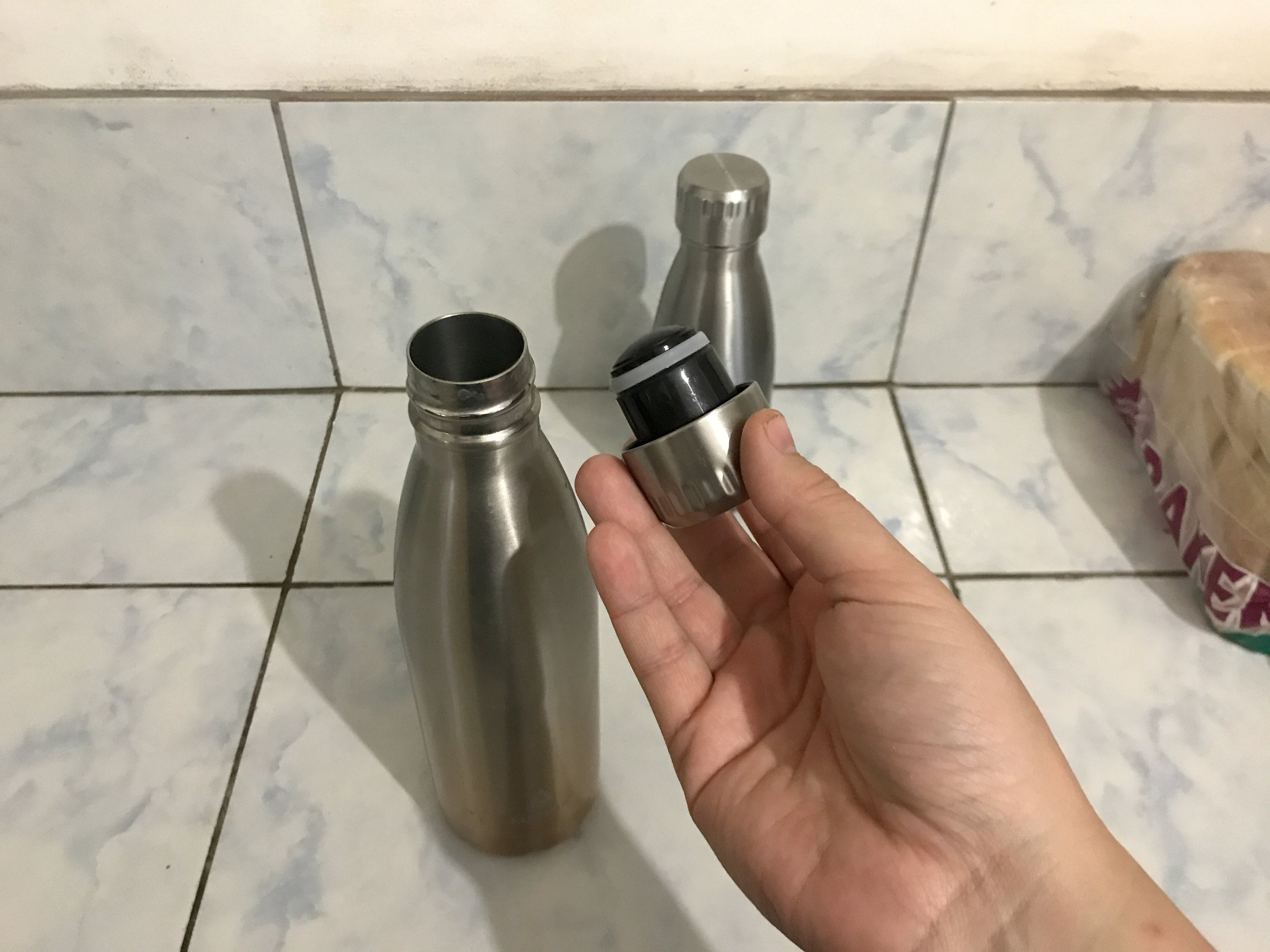 The caps create a vacuum seal and they take up some space. Don't make my mistake and fill the bottle up too much or you will spill boiling hot water everywhere! Seriously, it's every time with me! Fill it up only to the neck so you get a better seal with no mess.