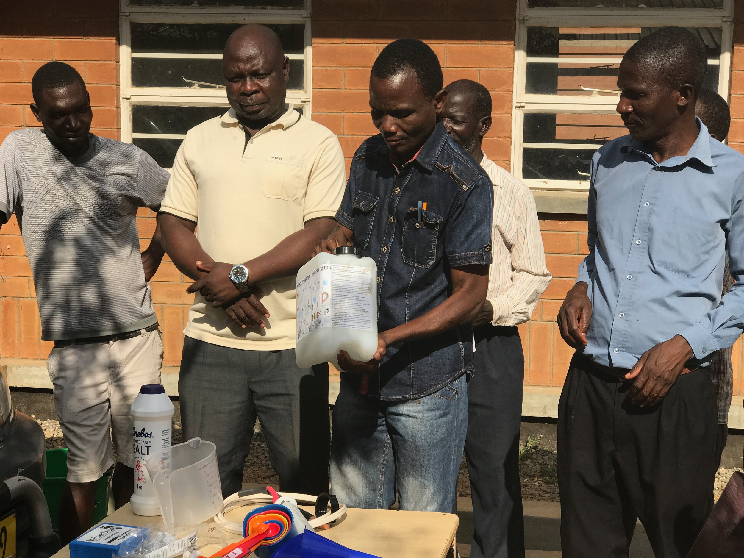 Preparing bleach for sale! Headmaster Mizeki has found other area schools who want to buy their excess bleach.