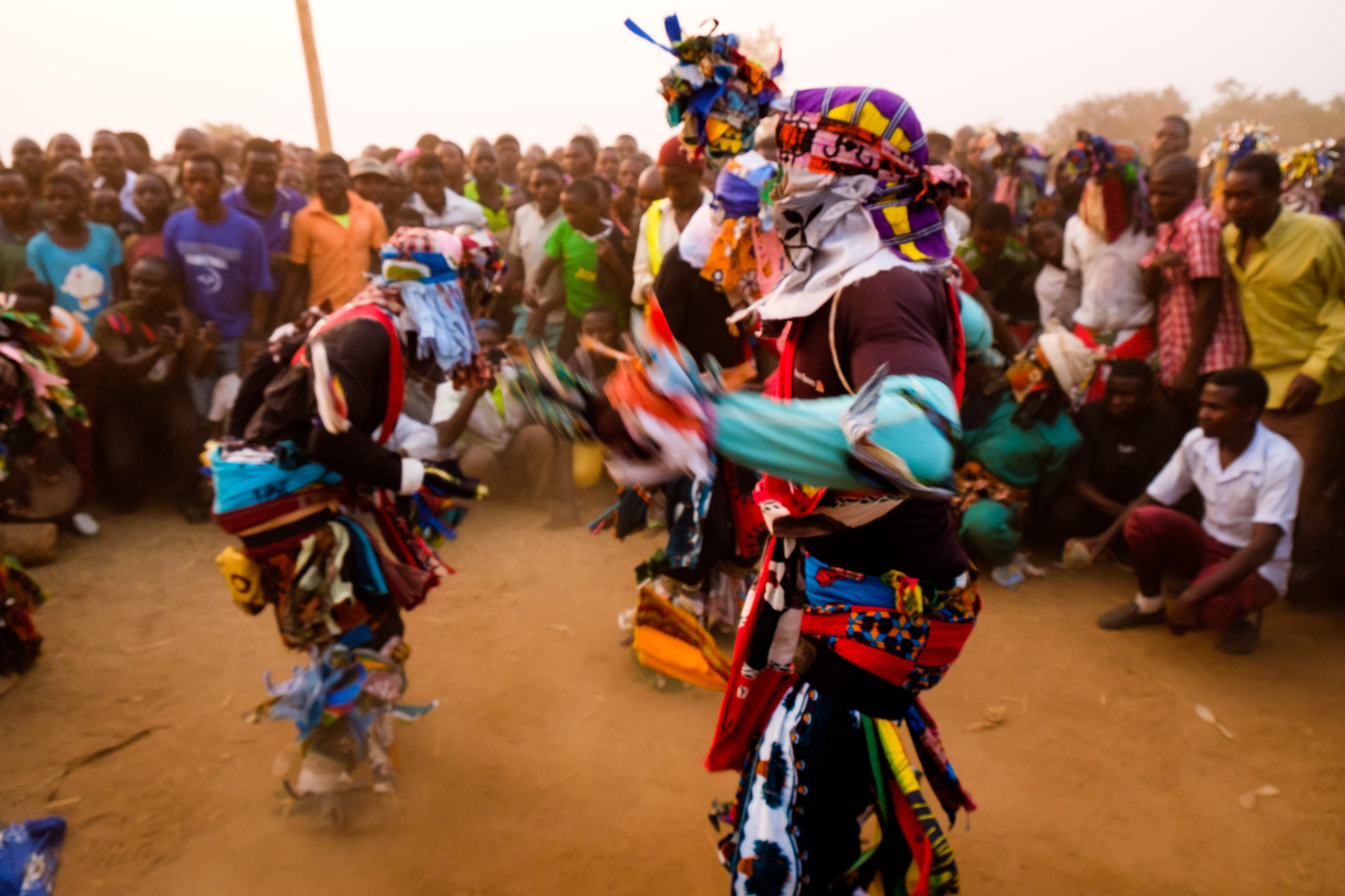 The crowed gathered around to see traditional dances performed by the masked performers.