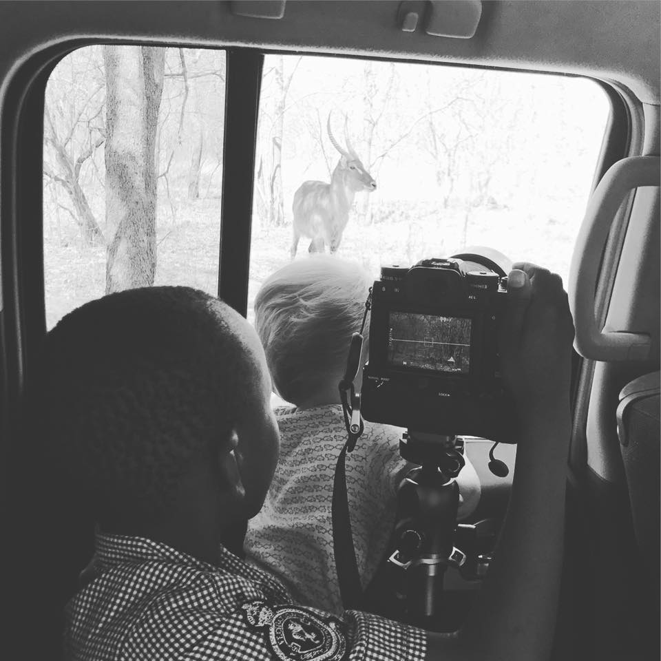 I took this photo of the boys looking out the window at a waterbuck