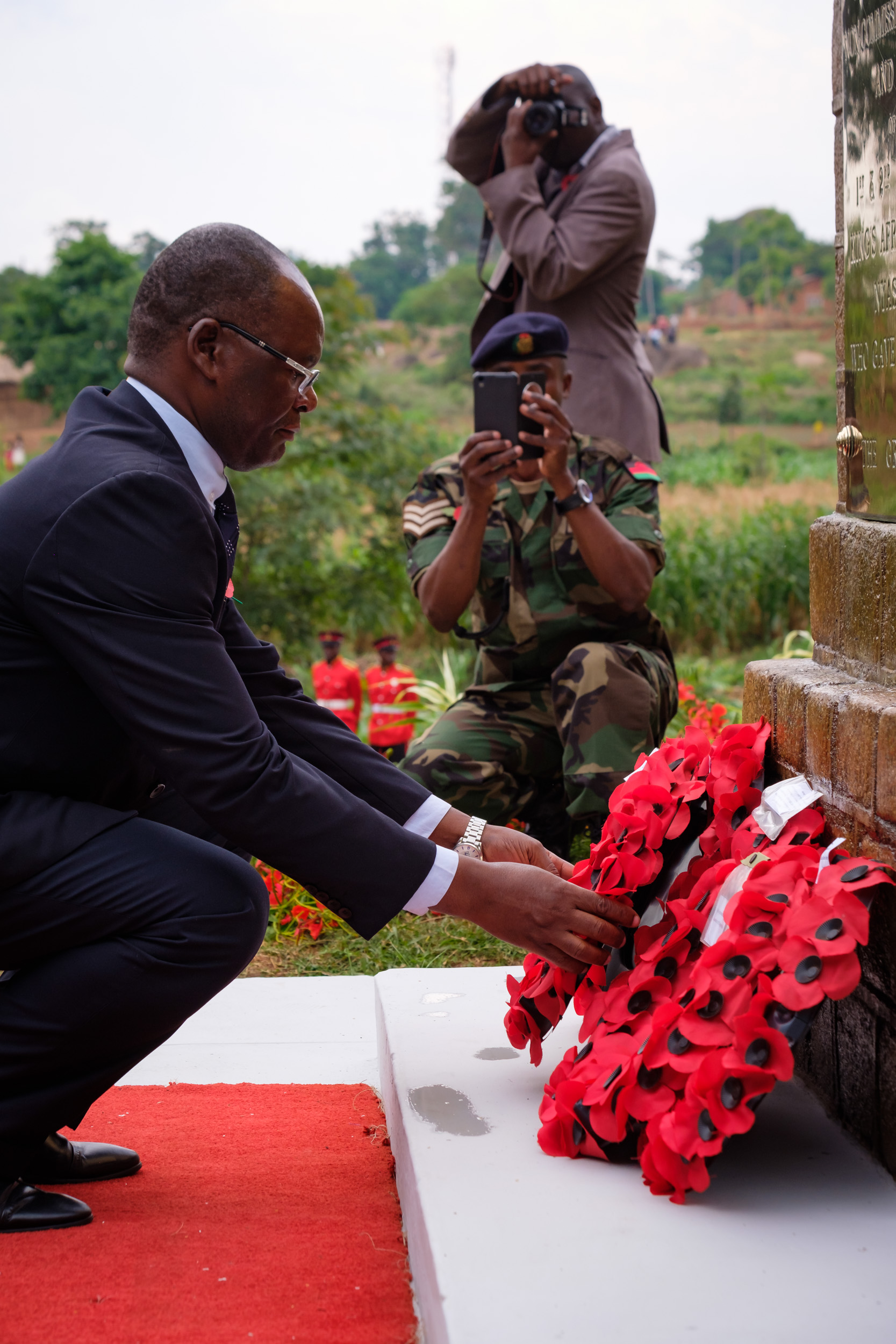 A local polititian lays a wreath.