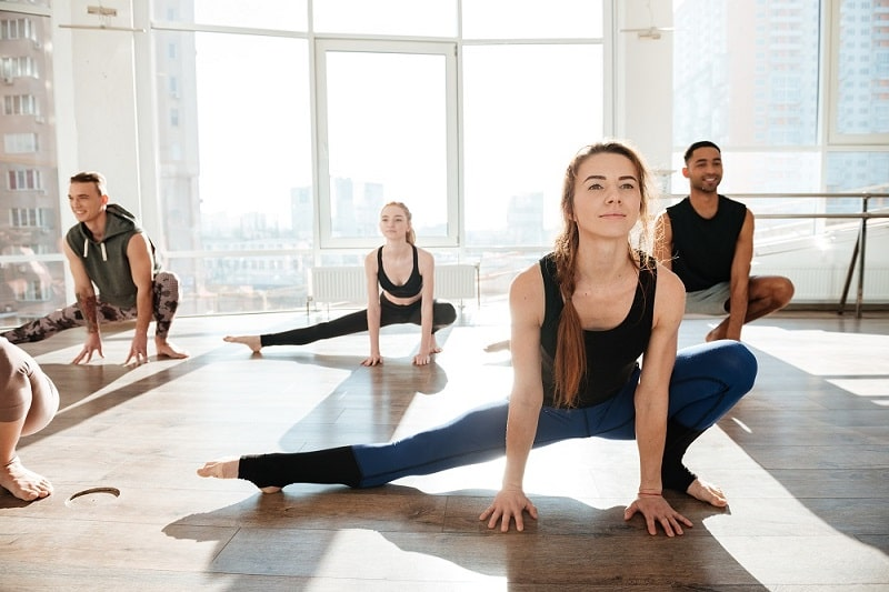 Apartment residents in yoga pose during a yoga class at their building