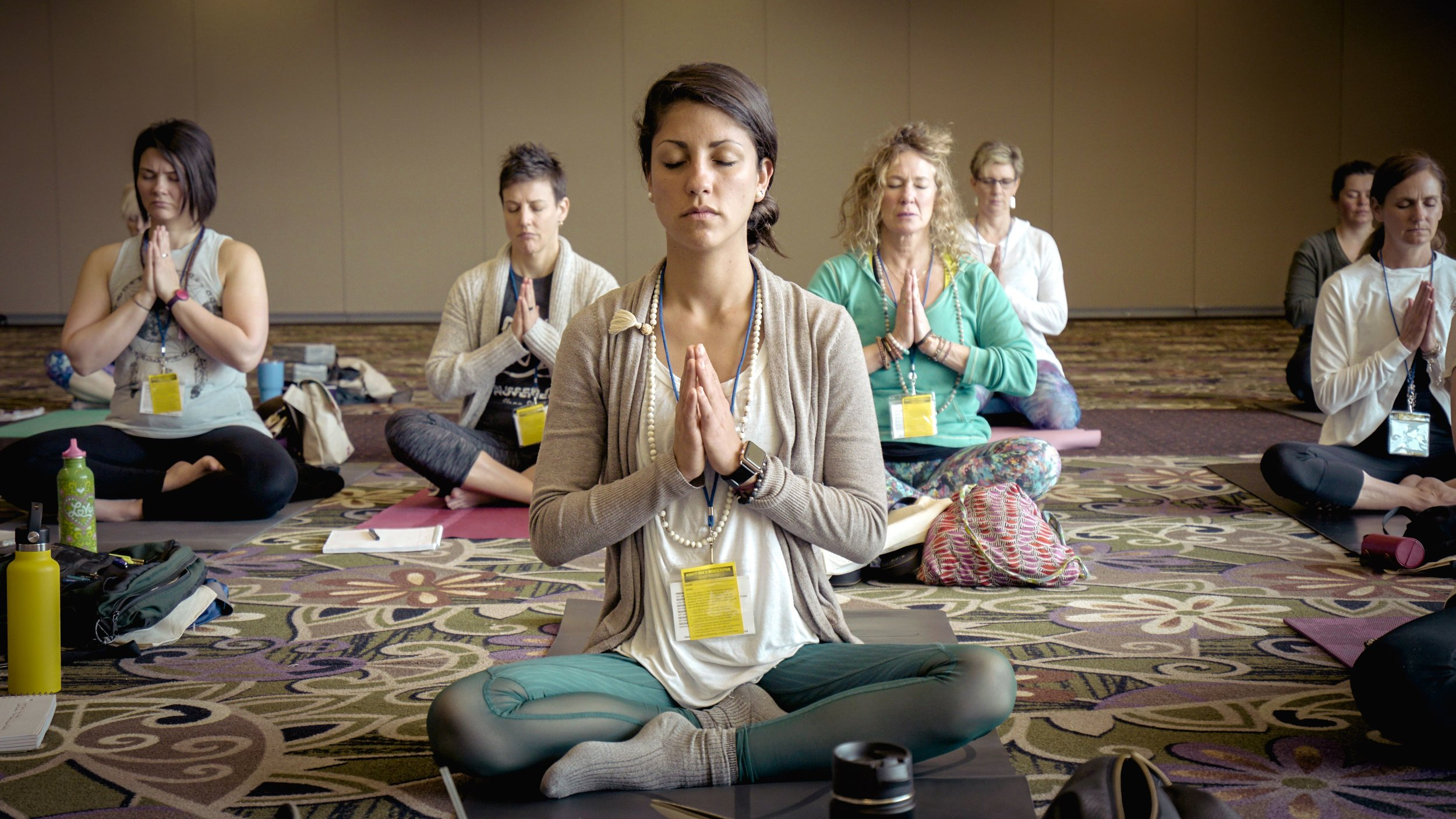 Yoga and meditation class during a business conference