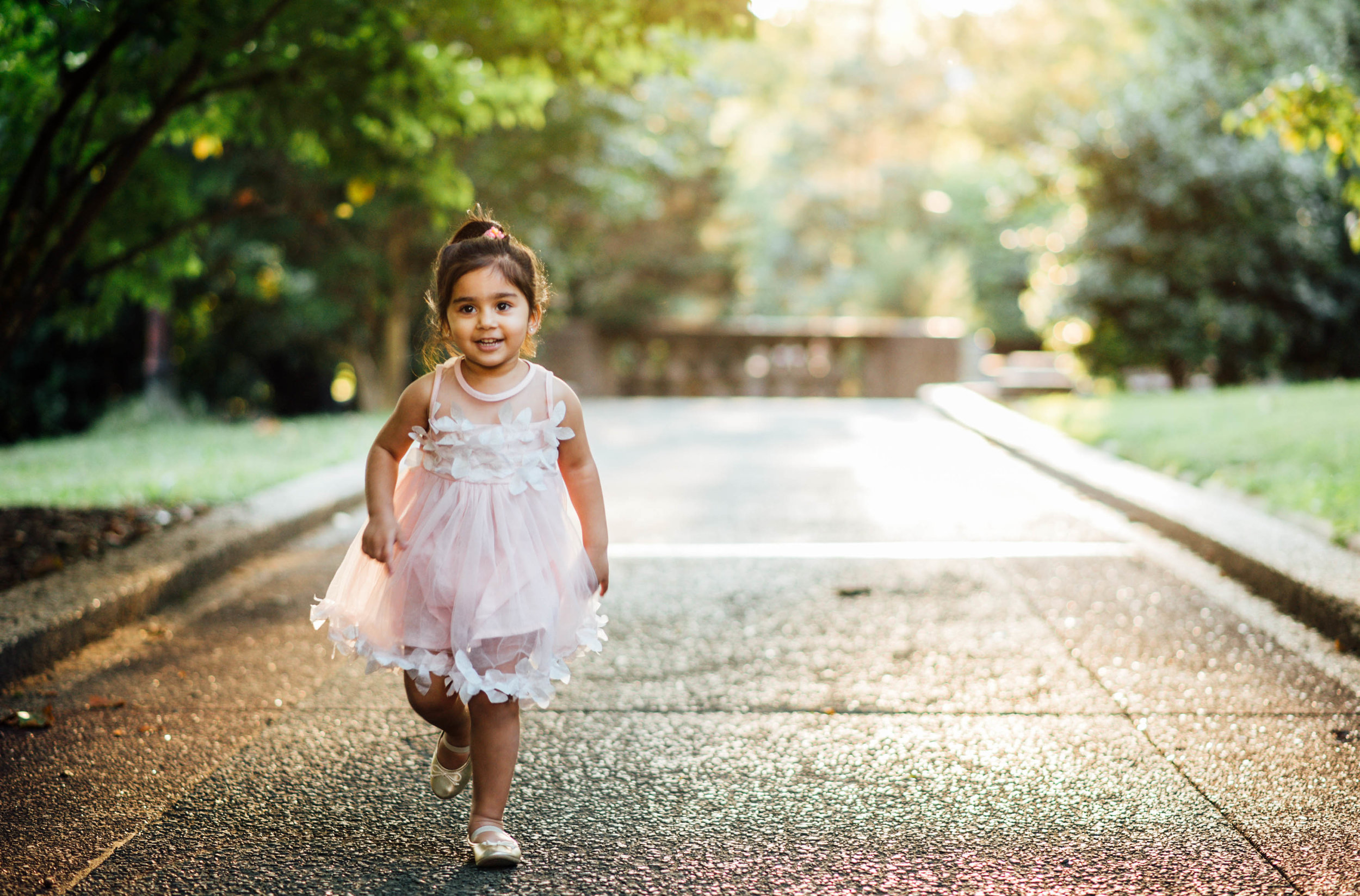 little girl in pink dress running in DC