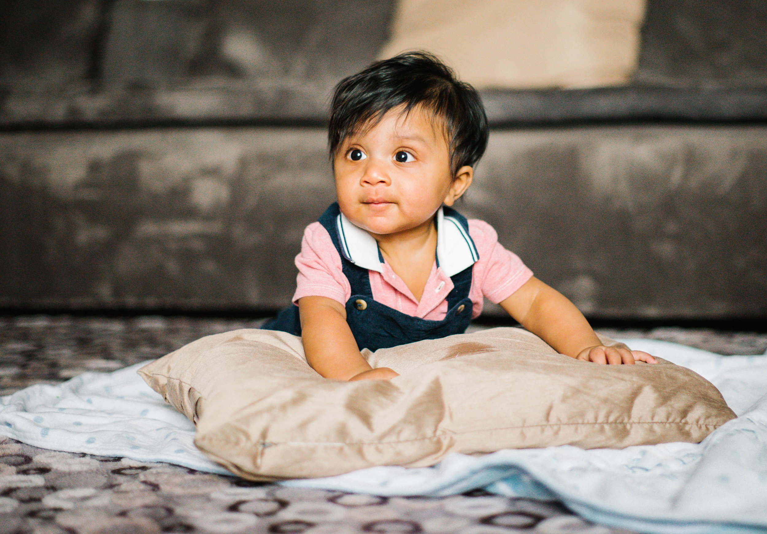 one year old baby with giant pillow