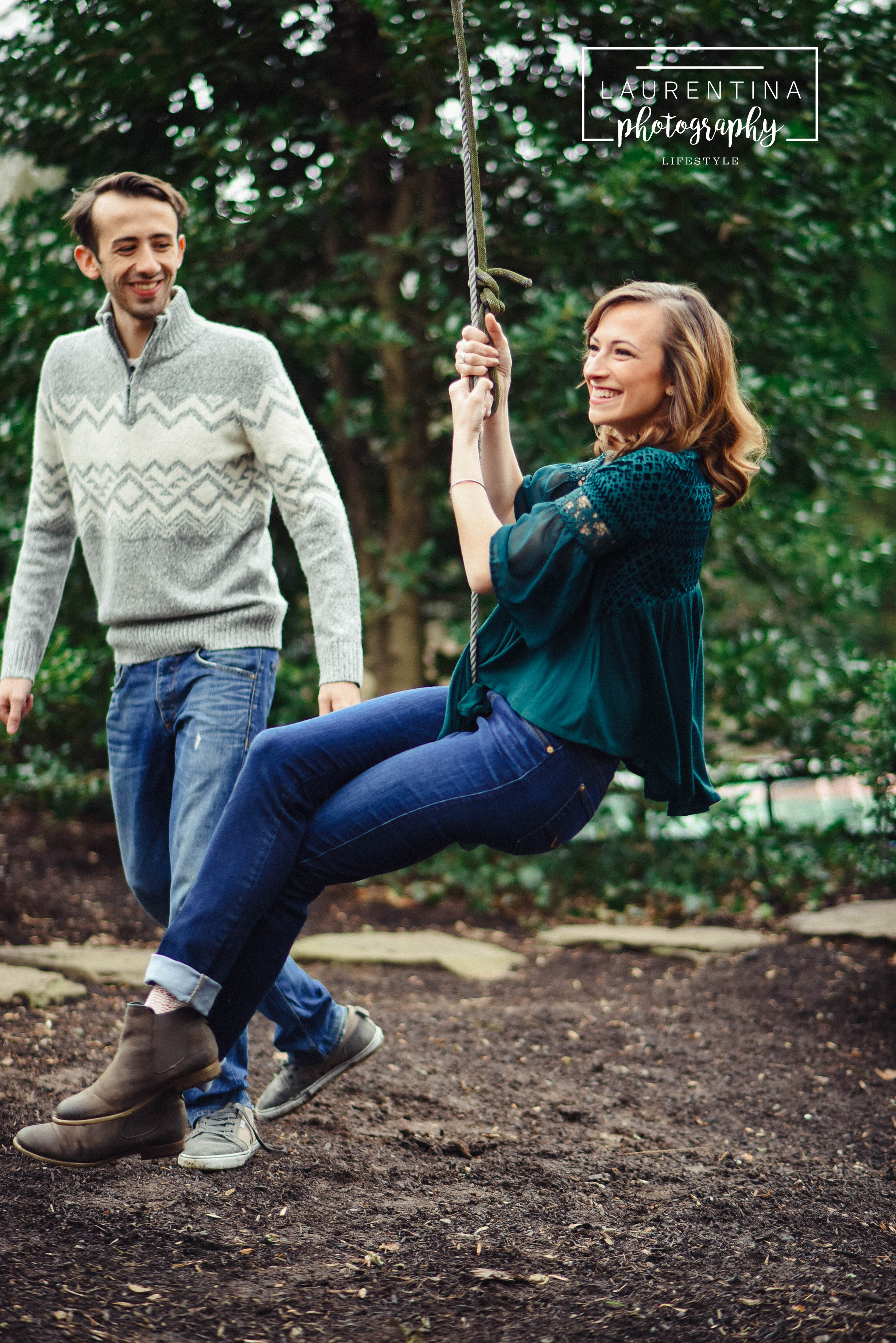 brother and sister on rope swing
