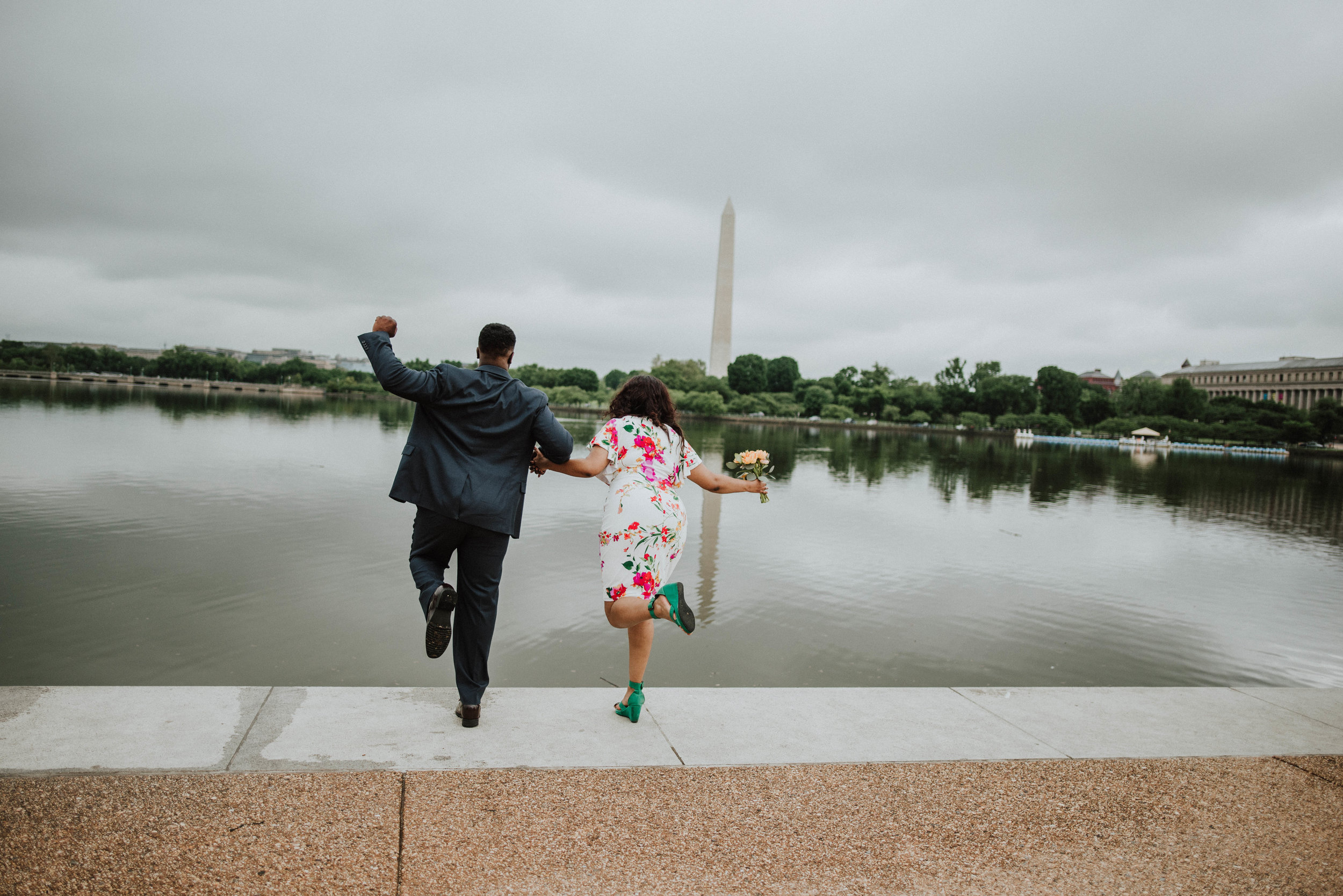 Jumping into the Tidal Basin at Washington Monument engagement pictures DC