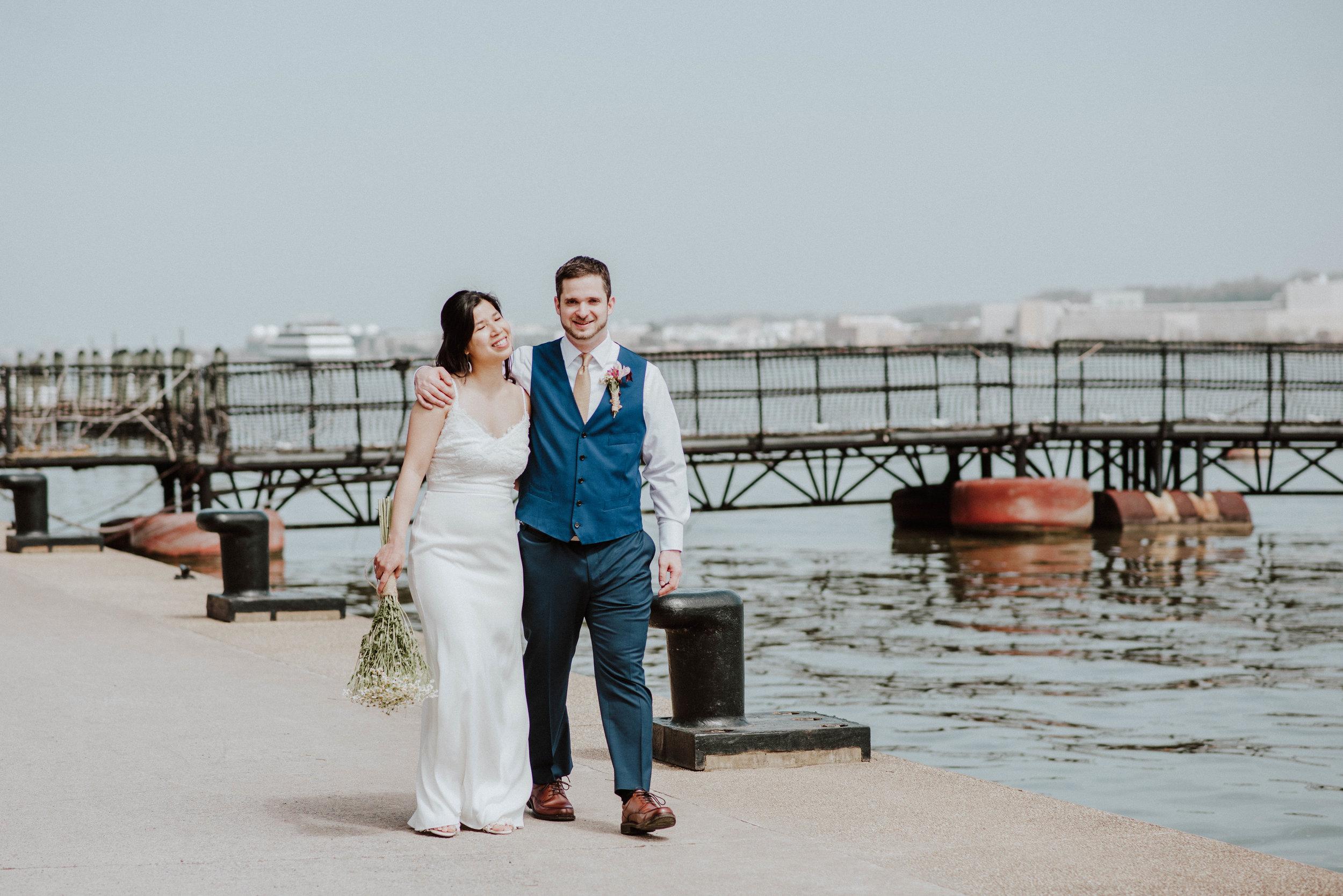 Bride and Groom walking along Alexandria Waterfront