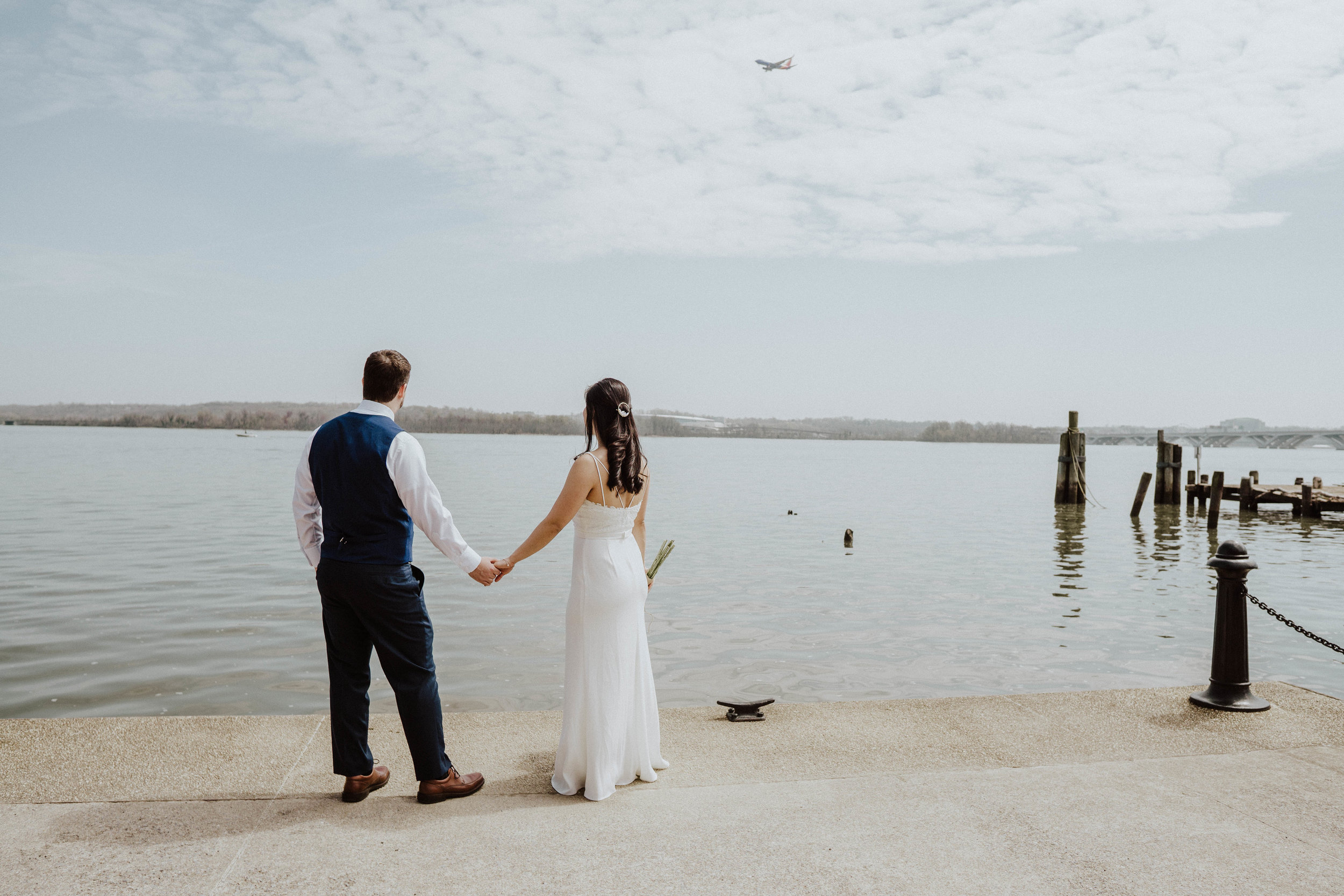 Airplane flying over Married Couple on Potomac River