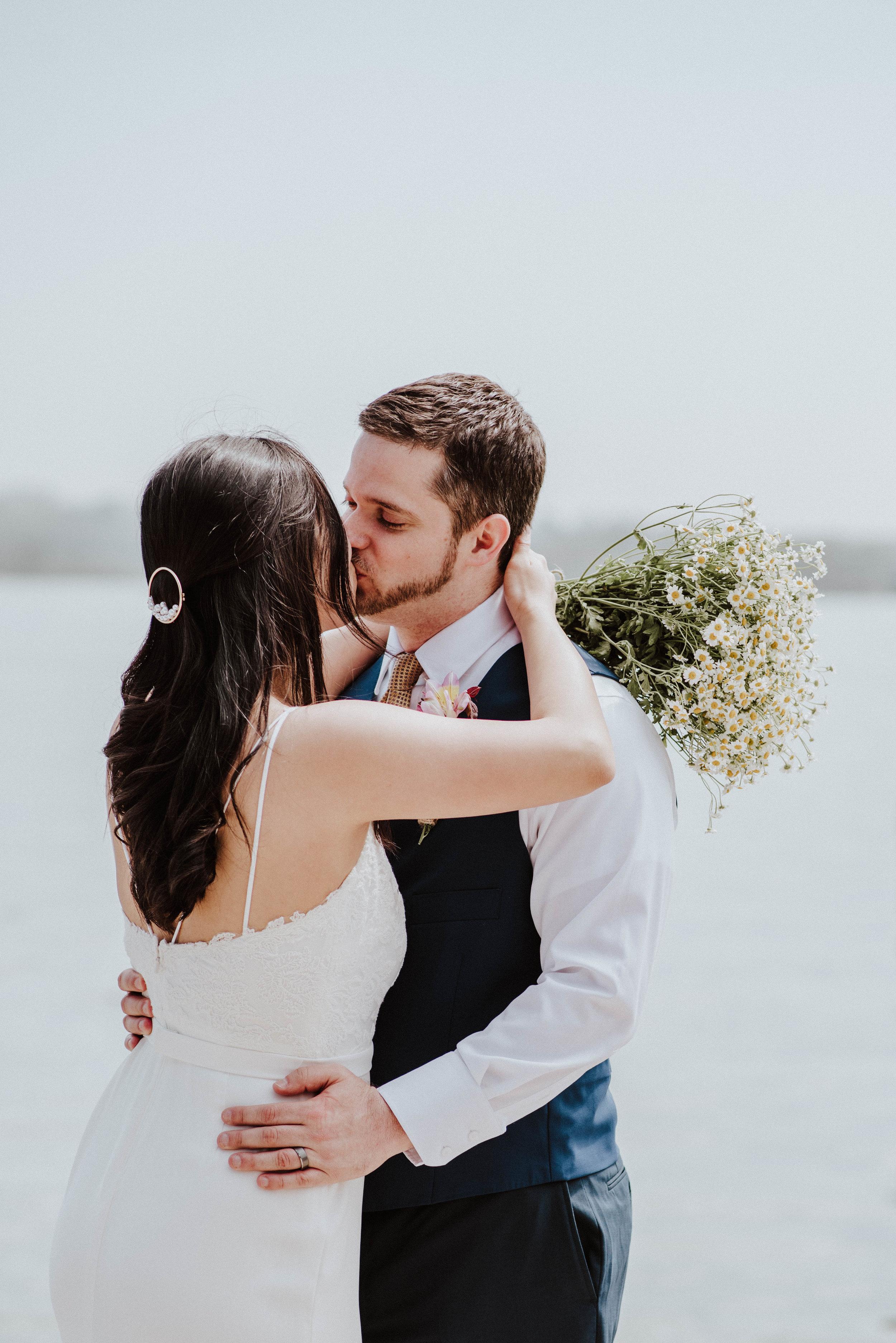Bride and Groom kissing on Potomac River