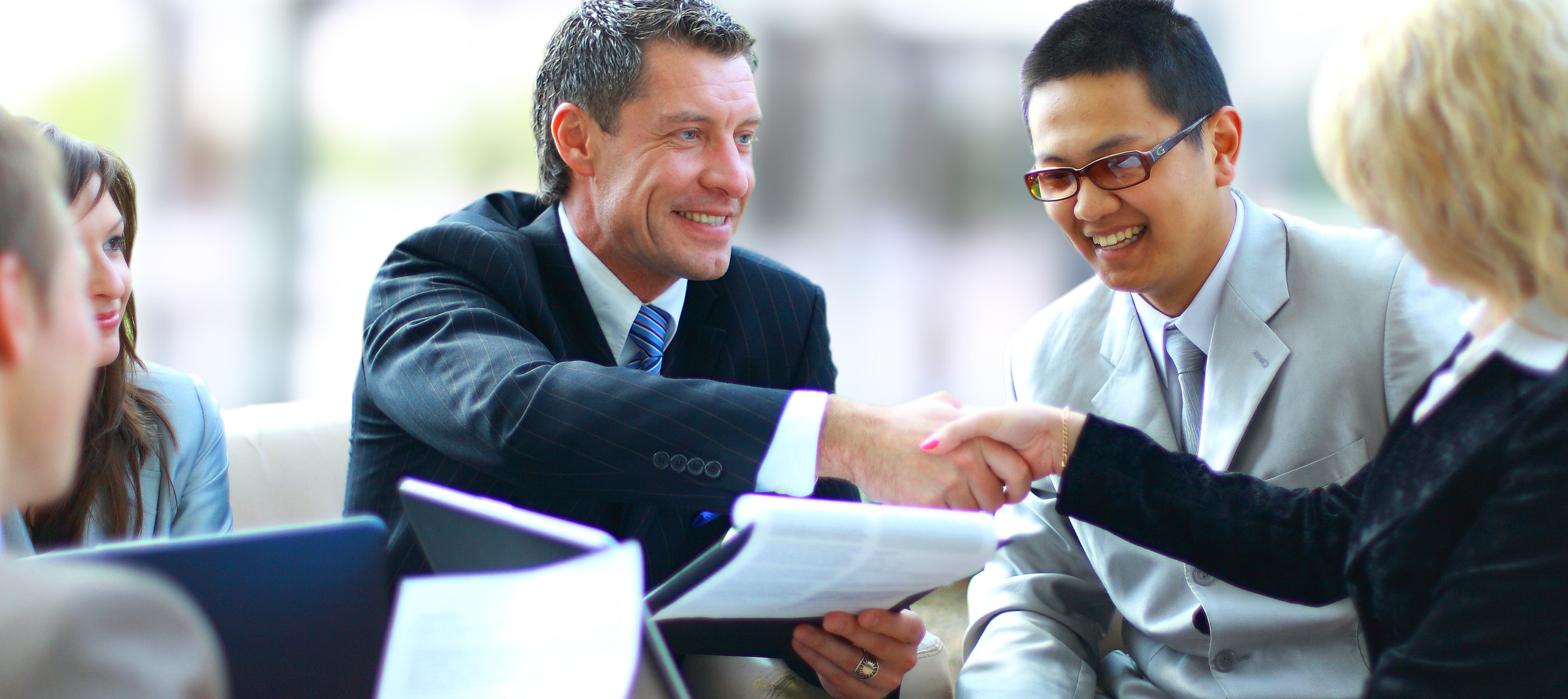 41683451-Black-man-and-white-woman-smiling-and-shaking-hands-in-office-building-Stock-Photo.jpg