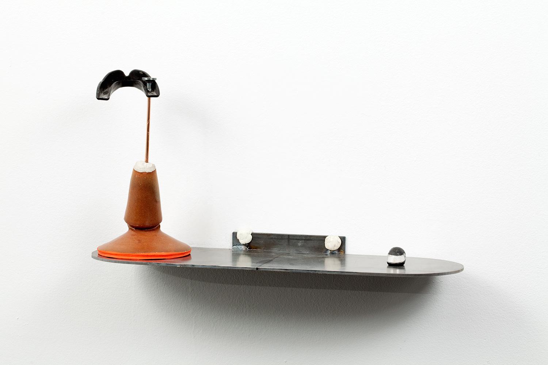 "Stuntman Trophy_1 . Ceramic, plaster, steel, copper, rubber mouthguard, chewing gum. 5.5"" x 15.5"" x 8.5"". 2009."