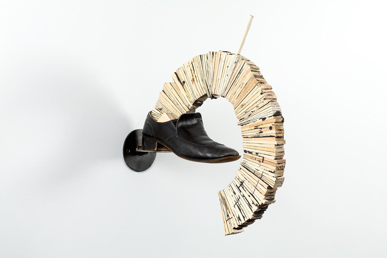 "Hedge. Pine shims, caulk, leather, steel, chewing gum. 20"" x 4.5"" x 18.5"". 2009."