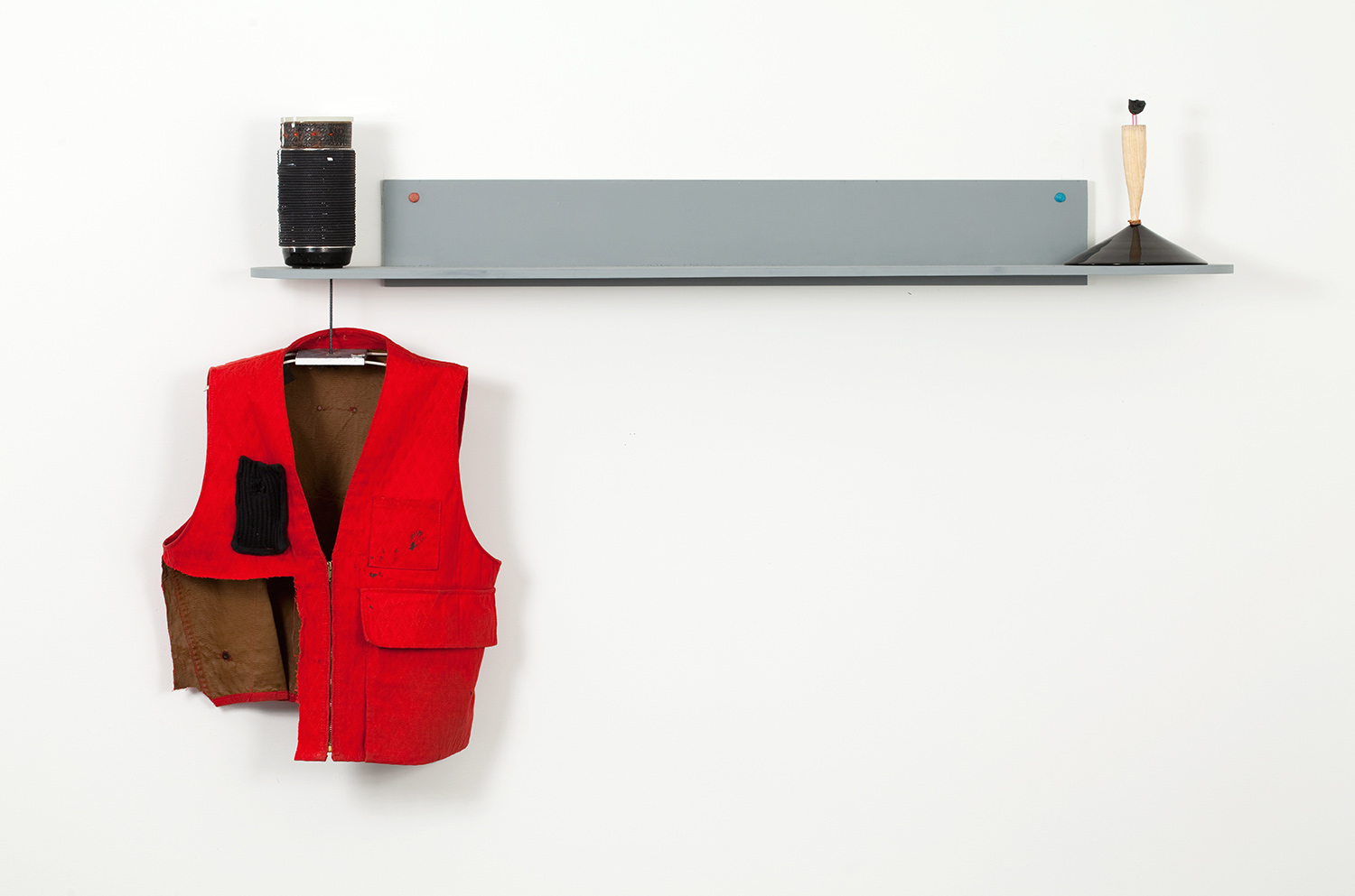 """The Resistants' Game Piece . Resistants' game bell: glass, oak, carrot, thumb from Labor Boss glove, eyebrow hair, stolen aluminum rod, plaster, copper. 37"""" x 54"""" x 9.5"""". 2009."""